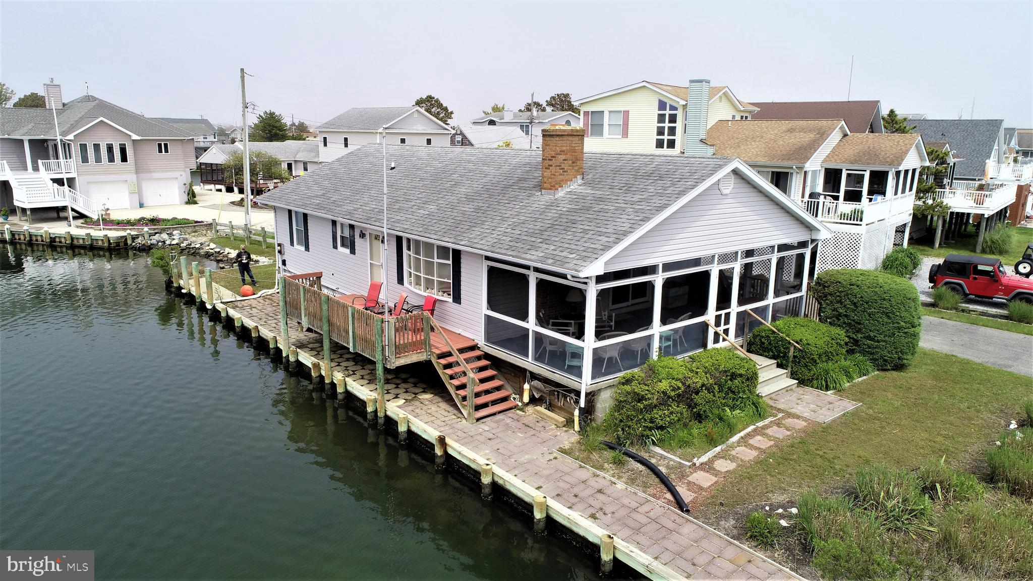 Excellent location with 100' of direct water frontage, fully bulkheaded. Three br. and 2 ba. with open side deck and a huge screen porch.  This home has never been a rental and has had only 1 owner. Short walk to the lifeguarded beach in Fenwick Island. Extra wide water way that should be suitable for a boat lift if needed.  Easy to show.