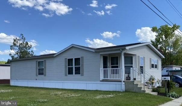 Welcome to Southampton Township. Well maintained 2008 Double Wide Mobile Home on a Large Corner lot with ample parking . This home features a large kitchen with LOTS of cabinets, full kitchen appliance package with stainless steel refrigerator, breakfast/office area,  living room and joining dining room (dining room table is included in sale) Nice size 2nd Bedroom, Hall full bathroom with tub, Master bedroom has 2 large walk-in closets, full bath with tub and double sink vanity. Ceiling fans throughout, Laundry room with 2 year old washer/dryer and leads to the side entrance to the patio for you to enjoy the outdoors and access to the driveway. (outdoor patio furniture included in sale) Storage shed off patio. Monthly land lease $615.00 includes water, sewer and property tax/lot fees. Buyer must be approved by Mobile Estates Park management.  Great School district, close to shopping and restaurants and JB McGuire-Fort  Dix.
