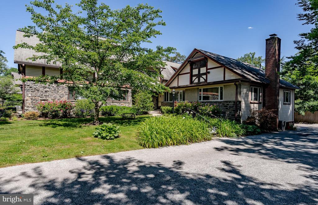 **VIRTUAL OPEN HOUSE LINK: https://zoom.us/meeting/register/tJEpf-mrqTsqHtP952Z7llLGnhas3bGTf_E-** Welcome to Red Leaf, a bucolic 5-acre estate community hidden away in the Main Line's very own Wynnewood. Red Leaf may be the best-kept secret of the Main Line, with only 21 units: 7 cottages, 6 villas, and 8 units within the manor. Enter down a tree-lined lane and admire the historic Frank Furness mansion as you find yourself approaching this picturesque end-unit, cottage-style townhome. Charming and well-maintained, this home offers plenty of space with its 3 bedrooms, 2.1 bathrooms, and 1,516 square feet. Unique to this unit is its spacious, newly constructed deck with custom awning, the perfect outdoor living space. Start your day here with a cup of coffee and end the evening with a glass of wine as you admire tree-filled views from this private setting. Inside, appreciate rare random-width peg hardwood flooring, upgraded LED recessed lighting, and freshly painted walls. The first floor is comprised of your kitchen, featuring tile flooring, wood cabinetry, and stainless steel appliances. This leads to your spacious dining and living area, filled with natural light thanks to a multitude of windows. This level includes a powder room as well. Upstairs offers a sun-filled master suite with picturesque, verdant views, 4 closets providing plenty of storage space as well as its own en-suite full bathroom. This floor features an additional two bedrooms, a full bathroom, convenient second-floor laundry, a generously-sized storage closet, and access to your attic. Other rare offerings of the Red Leaf Community include a private garage just steps away from your unit, beautiful, peaceful grounds, as well as an association which uniquely covers ALL utilities (excluding cable and internet), exterior maintenance including roof, and common area maintenance. Red Leaf is care-free living in a quiet setting walkable to the best of Wynnewood living, including the R5 train, shopping, a
