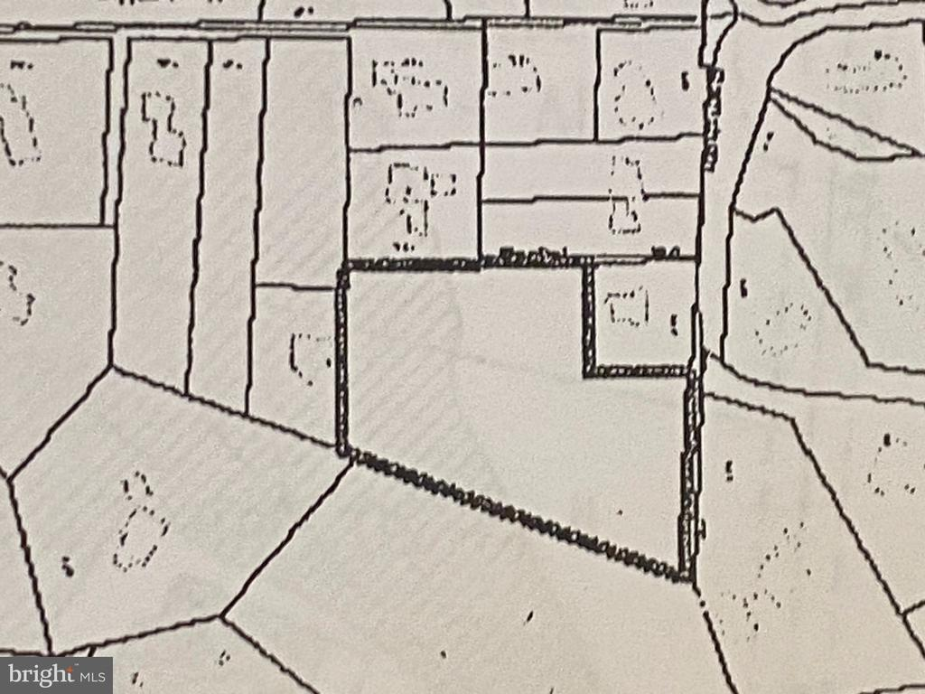 Great 2.87 Acre lot close to the heart of Mclean. Currently zoned R1 for 2  lots.  Proposed  R2 rezoning plat for 5 -lot subdivision in photos.
