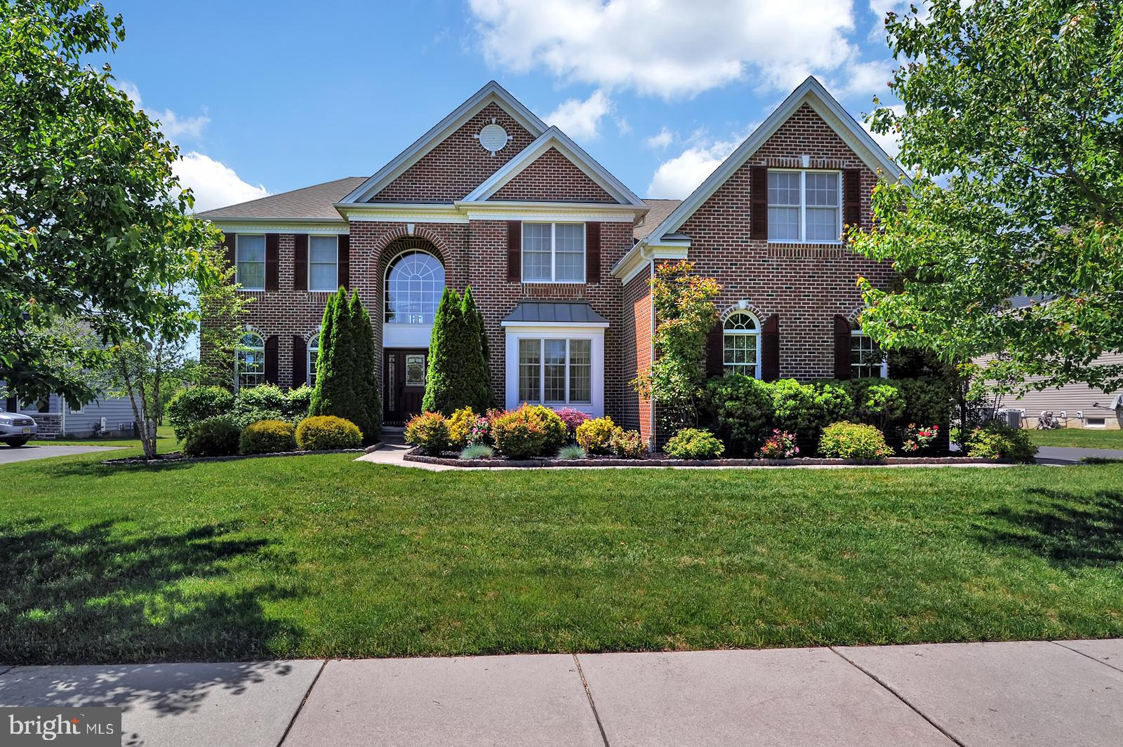 This stunning 5 bedroom 4 an a half bath home is located in the sought after community of Red Lion Chase! The beautiful brick front offers enhanced and elegant curb appeal as well as beautifully maintained landscaping. Upon entering the home, you will be amazed by the split staircase and take note of the rich hardwood flooring that leads to the oversized eat-in kitchen. Complete with walk-in pantry,  oversized center island, and stainless steel appliances. In addition to an open floor plan concept, as well as a living/dining room combination with a stone fireplace and family suite with full bath.. Upstairs you are welcomed by 4 additional bedrooms, including the master suite with 3 walk in closets, beautiful tile bathroom  and a sitting room. Another bedroom with attached bathroom and 2 additional oversized bedrooms with walk in closets and a shared hall bathroom.  In addition, there is an oversized side entry 3 car garage perfect for storage and a beautiful composite deck perfect for lounging. Also, enjoy the community amenities, swimming pool, tennis courts, clubhouse and fitness center - schedule your showing today, meticulous home will not last long!