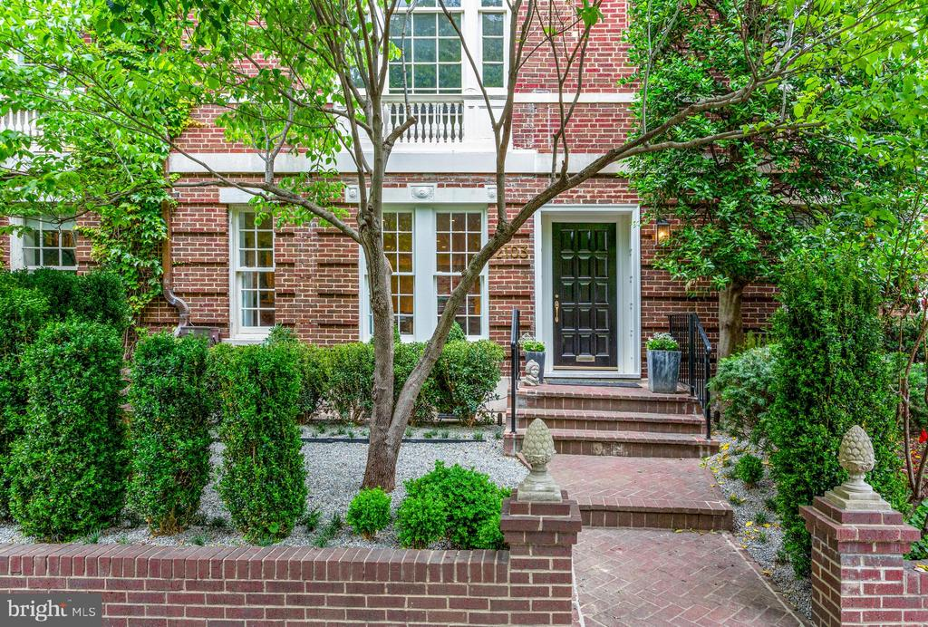 Open House Sunday 7/12 1-3pm - We are proud to present this meticulously renovated Georgian Revival home, originally built circa 1906 by notable Georgetown professor and military ophthalmologist William H. Wilmer. Ideally located in Kalorama Heights, one of Washington DC~s most refined and exclusive neighborhoods, the home boasts the stately polished appearance expected along Embassy Row. This masterfully crafted and reimagined three-bedroom home includes an extraordinary new kitchen featuring Wolf and Thermador appliances, solid wood cabinets by Blum, and quartz countertops. A large table-sized quartz island, with a custom walnut waterfall edge and bar seating, provides an elegant and flexible space for cooking and entertaining. Upstairs, on the primary living level, there are 12-foot ceilings, a stunning floor-to-ceiling Palladian window, intricate period moldings, an impressive mantel with wood-burning fireplace, a powder room, and access to a palatial private patio. The third floor includes two spacious bedrooms and a full bathroom featuring timeless marble tiles by Waterworks and a designer vanity. The top floor reveals a private master suite with incredible views, complete with a walk-in closet and a luxurious master bathroom, which also features marble tiles and premium finishes. Additional amenities include a private elevator with access to all four floors and a dedicated parking space.