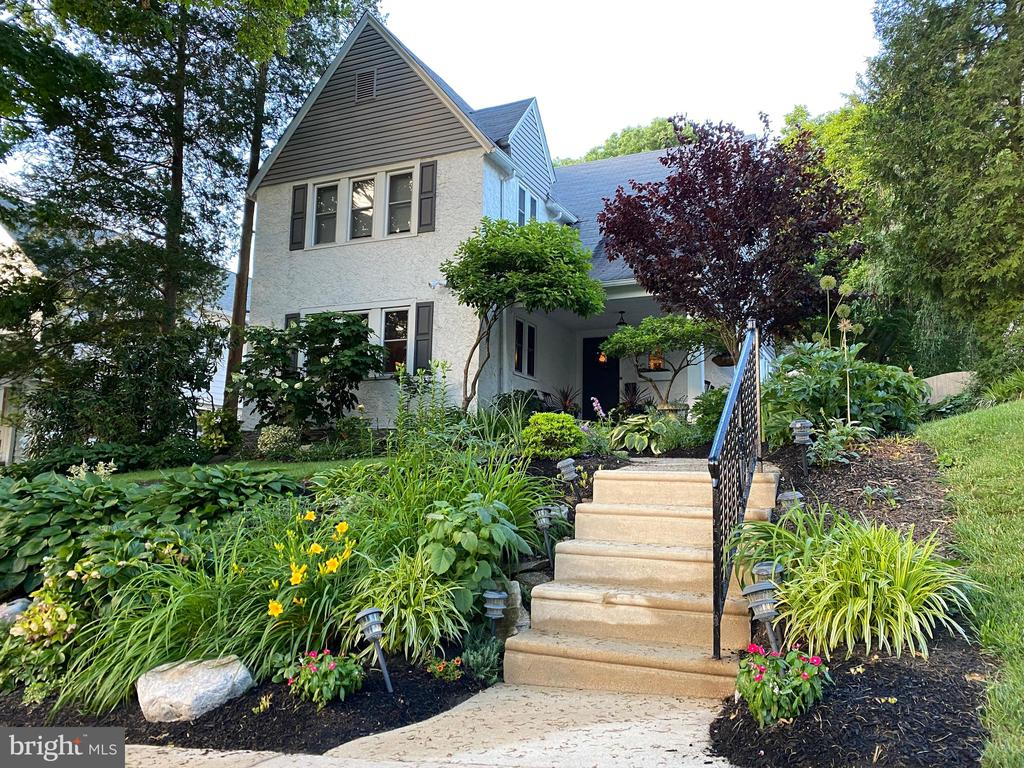Welcome home to this beautiful 2,425 sq. ft home located in the very desirable Penn Wynne Area and award-winning Lower Merion School District, convenient to everything! The home has been lovingly maintained, upgraded and is move in ready. The owner added numerous tasteful upgrades, including completely renovated main bath and powder room (2019), new water heater (2017), all new light fixtures, fresh paint throughout and a new Google Nest thermostat. Walk up the steps to a welcoming covered front porch and enter a spacious foyer to see hardwood floors and ample closet space throughout. Soak in the large living room which features a marble surround wood burning fire place and opens to the dining room with large built-ins. Step down to the family room w/beams, tile floor, bookshelves and newer sliders which lead to a flagstone patio, perfect for BBQ and entertaining. Completing the 1st floor is a spectacular custom kitchen with an awesome venting hood, custom cabinets and stainless-steel dishwasher and refrigerator. On the second floor you will find a large master bedroom with an ensuite bathroom. Two additional bedrooms and a new renovated full bath. The 4th bedroom is large & set off & could be an au pair suite. The pull-down attic offers a ton of storage opportunities. Basement has an outside entrance, additional storage and even room for a workshop. The outside features custom built raised vegetable cedar garden and extensive landscaping (all new shrubs, perennials and 600 bulbs). A brand new 8~x4~ Cedar Shed and 6~ privacy fence complete the property. Wonderfully convenient location as this home is only a few blocks walk to Penn Wynne Elementary, Wynnewood Valley Park, Penn Wynne Library, Kaiserman JCC, Penfield Station of the Norristown High Speed Line, Karakung Drive and a short drive to plenty of shopping and restaurants. A fabulous home with so much to offer you should call it home! Schedule your showing today.
