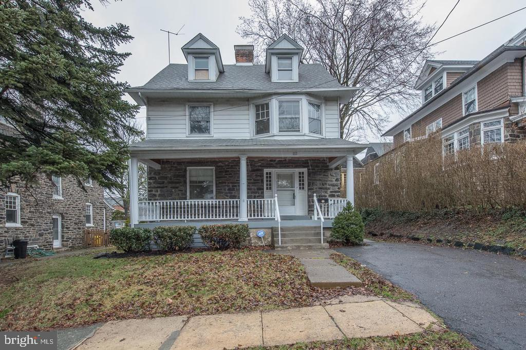 VIRTUAL OPEN HOUSE SUNDAY 6/21/20 @ 1PM. REGISTER HERE: https://us02web.zoom.us/meeting/register/tZ0pfu2urD8pEtP7zEGMjgal2TyF3BUVK3hEInvestor and end user alert!  This colonial sits just steps from downtown Narberth.  It features a large covered front porch, original hardwood floors, stone fireplace, and lots of original woodwork throughout.  The first floor opens to a large living area flowing to a light filled dining/family room.  The kitchen sits at the back of the first floor with a bump out mudroom, gas range, dishwasher, and white cabinets.  A powder room situated between the dining area and kitchen complete this level.  The second floor offers 3 large bedrooms, a full hallway bathroom, and a powder room within the master bedroom that can be conveniently renovated into a full master bath suite.  The third floor features 2 additional bedrooms.  The unfinished basement houses the laundry and allows for extra storage, and possible extra living space.  The flat back yard is a great space for children to play and host a BBQ.  Located within the Lower Merion School District, and close proximity to downtown Narberth this home is ready for it's next owner!  HOME IS BEING SOLD AS-IS.