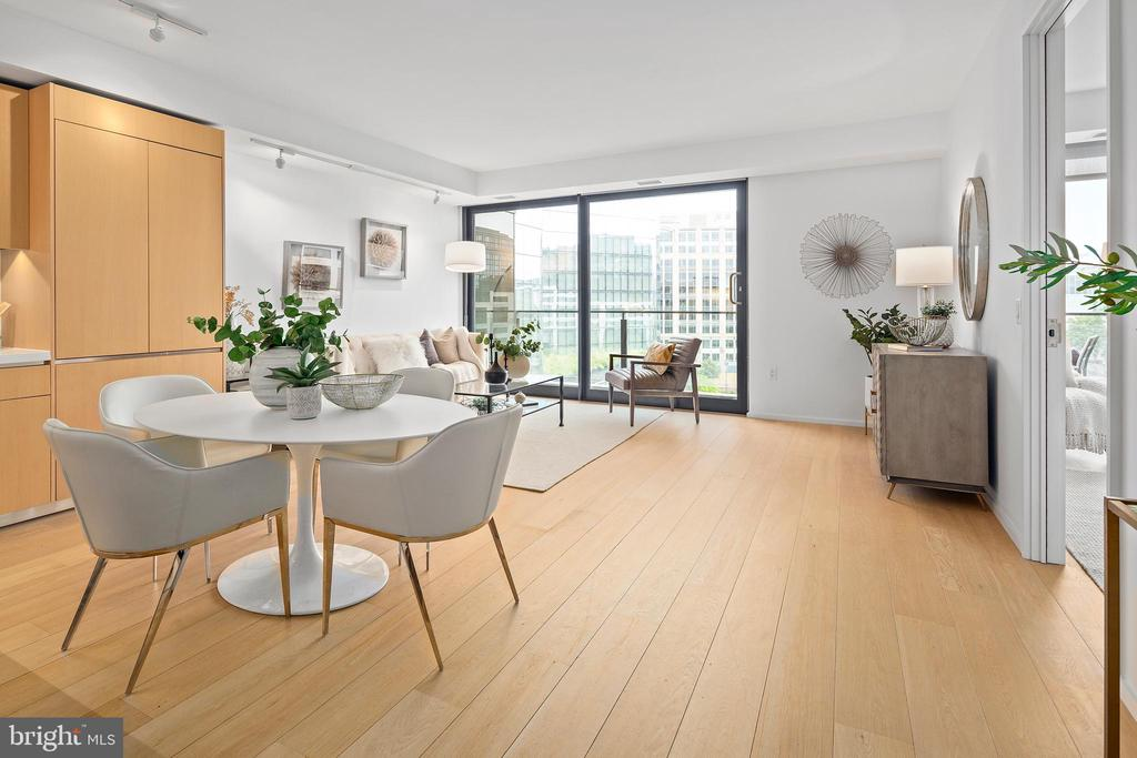 New Price at CityCenter! This listing is available to tour 7 days a week by the listing agent! Live in the lap of luxury in Washington DC's premier full-service building, The Residences at CityCenter. Designed by internationally renowned architecture firm Foster + Partners, Unit 803 boasts 750+ square feet of living space with 1 bedroom and 1 full bath and a private balcony. This unit features white oak hardwood floors, sleek contemporary finishes, a chef's kitchen with Molteni cabinetry, and gorgeous views of Downtown, DC through the floor-to-ceiling windows. This light-filled modern interior condo is move-in ready and comes with an assigned private parking space in the attached underground garage. Building amenities include 24-hour concierge services, security, a wine room, private rooftop lounges, 2,700 sq ft fitness center, a yoga room, and a rooftop pool. Just blocks to the METRO, luxury shopping, Michelin-starred restaurants, and everything the city has to offer. View 3D Tour Here: https://my.matterport.com/show/?m=HVydwk5yy1n