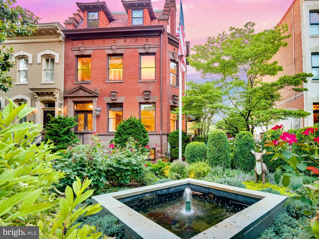 """VIEW THE PROPERTY VIDEO HERE: (https://youtu.be/OH4KYJ9a76c)   Truly a """"once in a lifetime opportunity!""""  The iconic Deer House is considered by many to be the premier residence on Capitol Hill.  Its commanding presence on East Capitol Street, just seven blocks east of the US Capitol, captivates all who pass by.  Constructed for and by stone mason Antonio Malnati in 1903 by architect George S. Cooper, the majestic stone and brick facade features a sandstone entry stairway, front entrance with an ornate stone pediment, beautifully carved keystones and distinctive stepped-gable party walls.  The double-width lot allows a graceful (and rare) side porch and courtyard featuring a hand-painted mural that transforms the space into a veritable Garden of Eden.  The site of countless garden parties, weddings, fundraising events, Halloween extravaganzas and family dinners, this space is unrivaled on Capitol Hill.  A true """"entertainer's dream,"""" the Deer House is widely known for hosting events for 200+ people.  From the elegant entry hall to the spacious and bright living room, the exquisite chestnut-paneled dining room and the massive and beautifully functional kitchen, the home is tailor-made for gatherings large or small.  Five bedrooms and three bathrooms occupy the second and third floors.  The master bedroom suite features 2 walk-in closets and en-suite bathroom.  A large in-law suite with two bedrooms and one full bathroom occupies the terrace level.  There is additional storage on this level for the main house including a walk-in wine cellar.  The detached two car heated garage includes a utility sink and abundant storage for bikes and garden tools.  The private driveway can accommodate an additional two cars.  Beautifully renovated and impeccably maintained by its current owner, the Deer House is an architectural masterpiece awaiting the next chapter in its storied history.  View the main house 3D tour here (https://my.matterport.com/show/?m=kwSCHL8z7a3&brand=0)"""