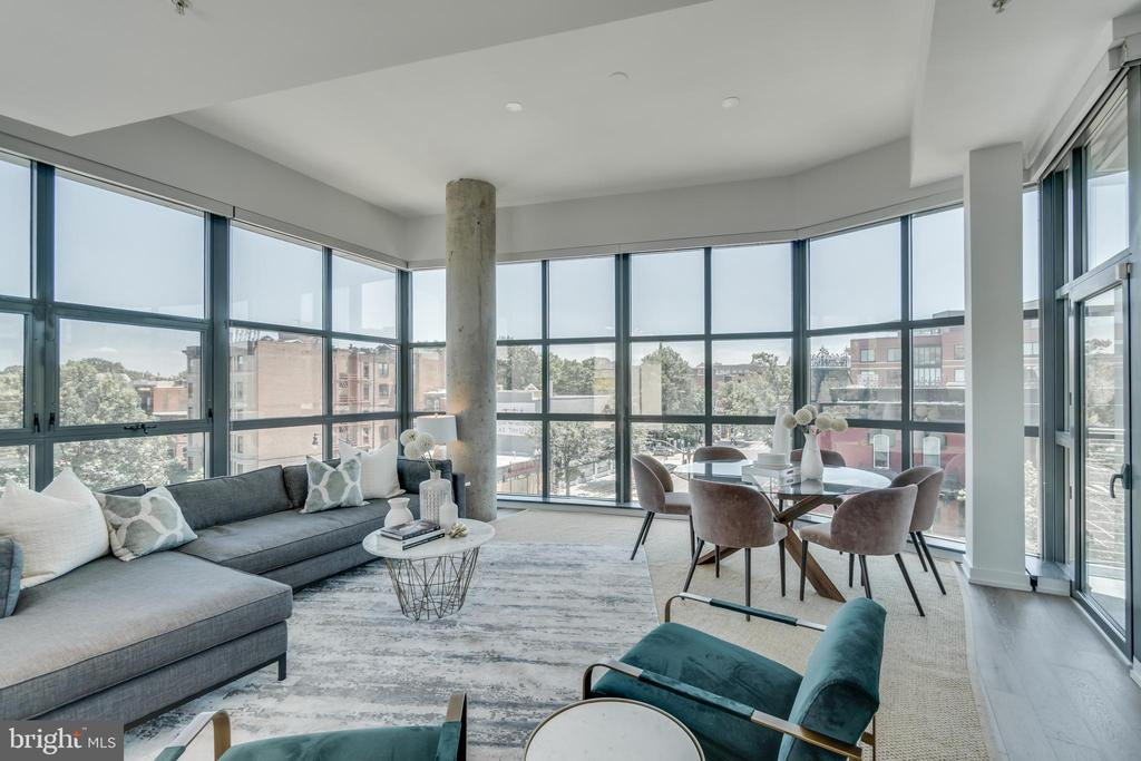 Massive New York Style Flat | 2 Bed | 1 Den | 2.5 Bath | 2,150 Sf | 575 Sf Private Terrace | 2 Separately Deeded Garage Parking Spaces | Building: Boutique Building, 18 Units, Elevator, Built-In 2006, Underground Garage | Unit: Open Floor Plan, Wide Plank White Oak Hardwood Floors, 67 Linear ft of Floor-to-Ceiling Windows, South Facing, Corner Unit w/ Amazing Views of 14th & P St, 11ft+ Ceilings, Custom Roller Shades, 2 Private Balconies, Designer Track Lighting, Recessed LED Lighting, Walk in Closet w/ Custom Built-ins in Master, Storage Unit | Kitchen: Kitchen Aide Professional Stainless Steel Appliances, Gas Cook Top, Axia Hood, Full-Size Bosch Dishwasher, Absolute Black Granite Countertops, Scavolini Cherry Custom Cabinetry, Appliance Garage, Grohe Faucet w/ Instant Hot/Cold Water, Island w/ Seating for 3 | Baths: Marble Tiling in Master, Granite Topped Dual Vanities in Master, Duravit Vessel Sinks w/ Jado Designer Faucets in Master, Frameless Glass Shower Enclosure, Scavolini Cherry Vanities w/ Storage, Slate Tiling, Grohe Fixtures, Full Sized Tub, Toto Toilets
