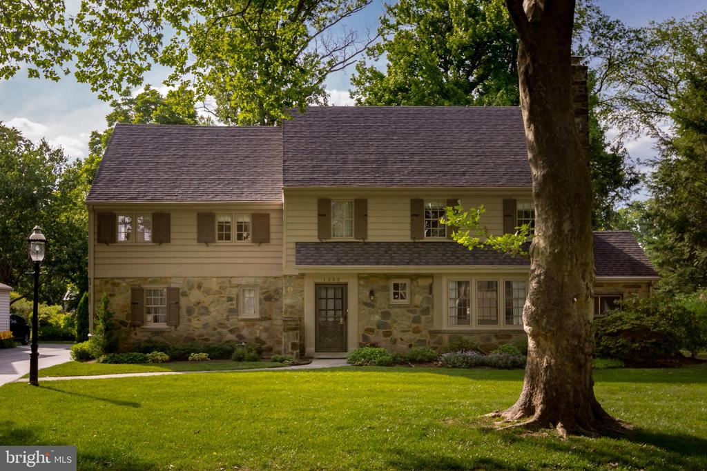 Welcome to this stately stone colonial with impressive curb appeal located on a quintessential Main Line street. Authentic and charming features include a fireside living room, deep-silled windows, quality millwork and wood floors. Enter into the classic living room which flows easily into the dining room and eat-in kitchen. A convenient powder room and a laundry room complete the main floor. There is plenty of room to work from home in this spacious abode. You will appreciate the second floor's four bedrooms and three full bathrooms.  The third floor has two additional bedrooms and a hall bathroom. Outdoor spaces include a delightful screened-in porch and a large and level rear yard with colorful landscaping. The attached garage and finished lower level offer additional space for storage, hobbies and recreation. This charming home is close to several township parks, library, Suburban Square, Whole Foods, regional rail and Amtrak service. The unmatched location is also within Lower Merion's exceptional school district. This well-maintained home is ready for an investment-minded buyer to make the sun-filled and versatile spaces their own!