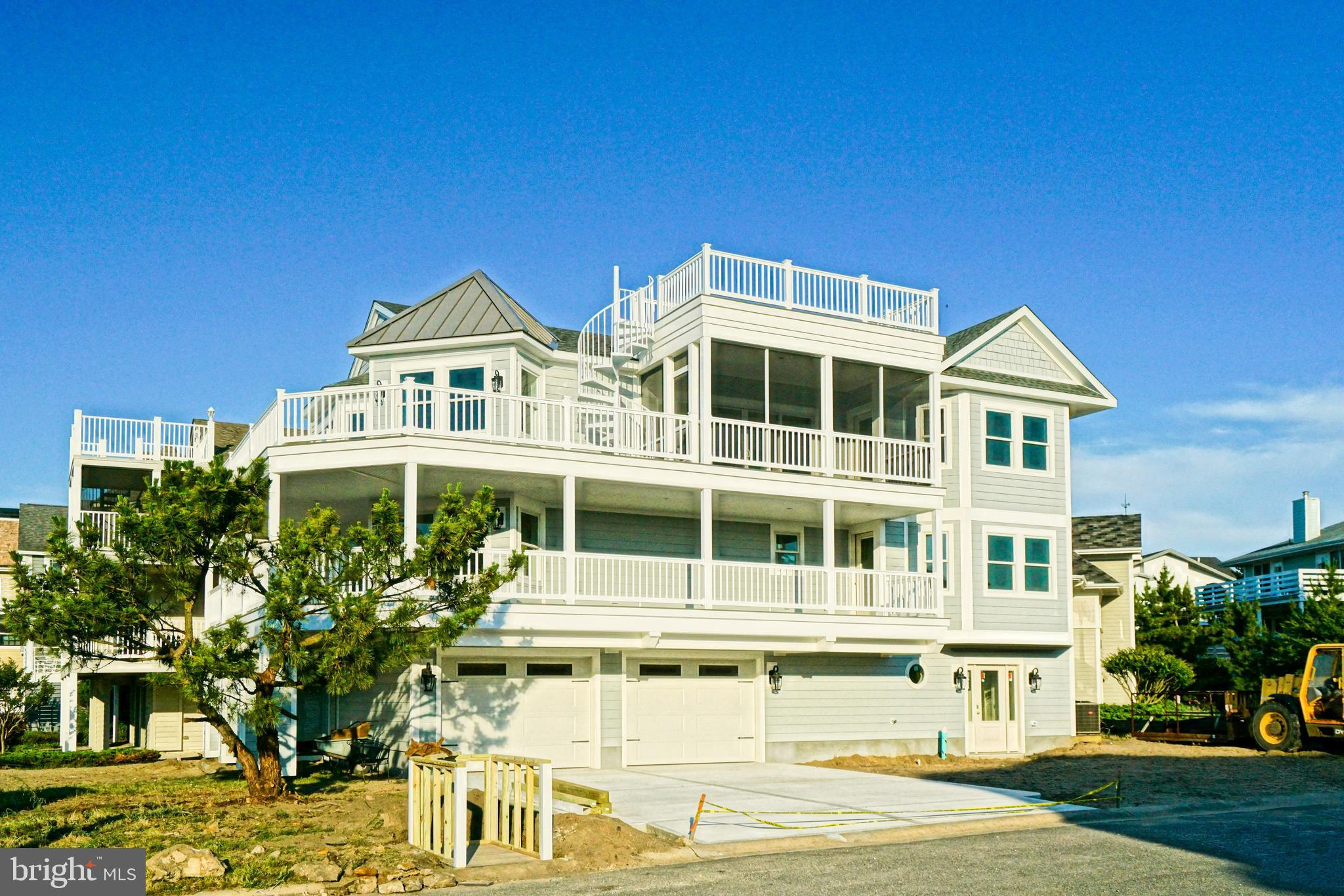 NEW CONSTRUCTION IN CAPE SHORES! Designed with supreme coastal living in mind, you're invited to experience it from the ground up! This new construction home offers 5 bedrooms, 3 Full and 2 Half Baths, and features an open, inverted floor plan - accentuating the property's fantastic beach block location, elevator, private master bedroom, plus multiple outdoor spaces to enjoy soothing bay breezes - including the rooftop deck with exclusive bay & state park views!  Located just across the street from the beach in the amenity-rich Cape Shores that offers community outdoor pool, tennis, private fishing pier, and sandy beach!