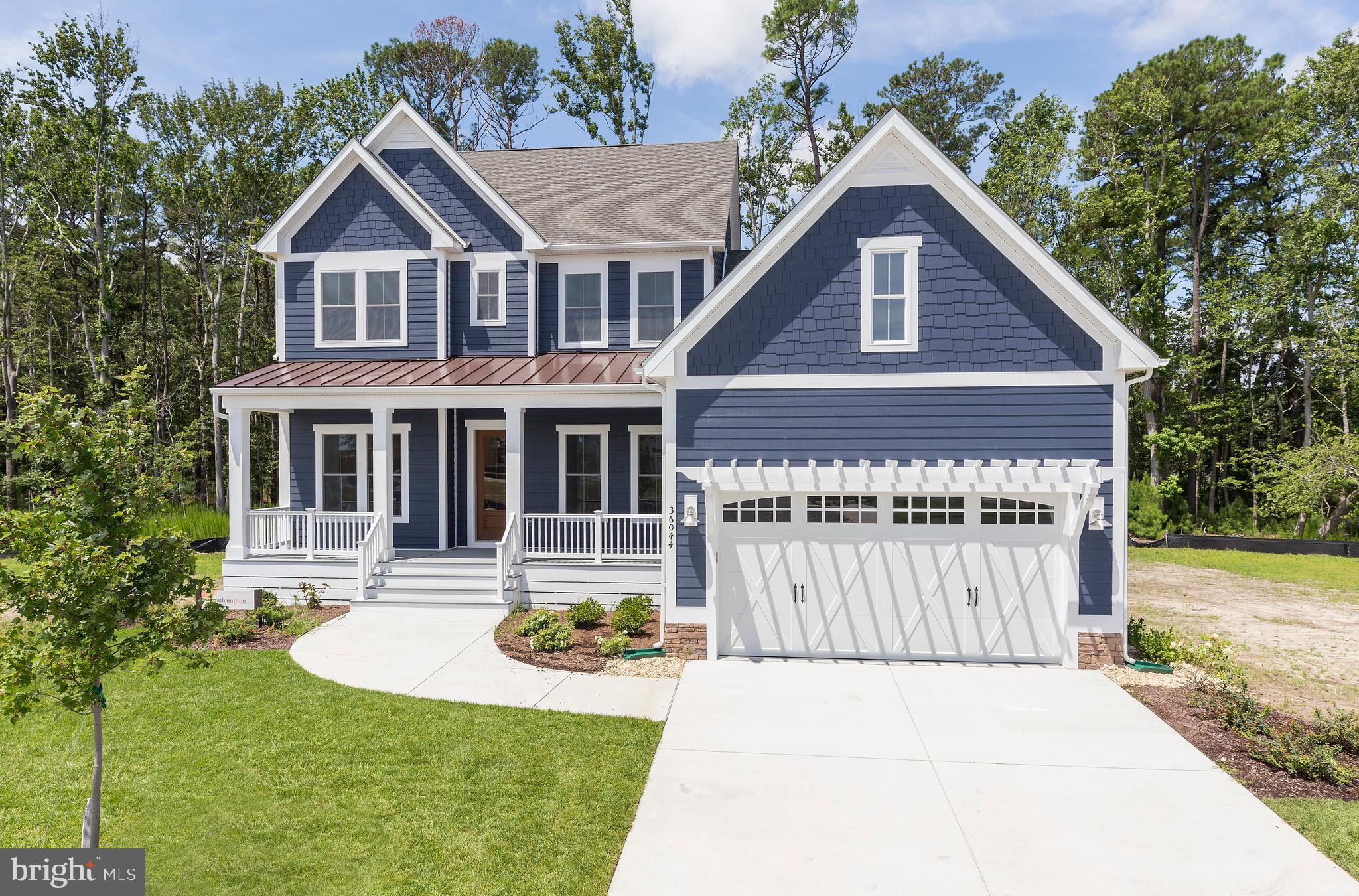 Coastal curb appeal at its best! https://www.nvhomes.com/new-homes/communities/the-estuary. The Southampton features 4 bedrooms, 3 bathrooms and offers the convenience of a first floor owner~s suite with upgraded Roman shower, a guest bedroom and a study. The open plan kitchen with airy morning room adjacent the great room is an entertainers dream! The designer kitchen includes large quartz island, ceramic farmhouse sink ugrade, abundant counter area and tons of cabinet space. Right off the main living area your outdoor living space is greatly extended - bring the indoors outside with a partia. covered porch in front and the addition of a first floor covered rear porch maximizing all of your outdoor entertainment spaces. The attention to detail continues upstairs with 2 additional guest bedrooms, a bonus room, and full bath - perfect for when family and friends visit you at the beach. Looking for additional storage? A large walk-in unfinished storage room is conveniently located off the upstairs bonus room. Upgrades also include the 'Williams' Designer Palette of interior finishes, upgraded kitchen cabinetry and tiled backsplash, tray ceiling in master suite, and more!