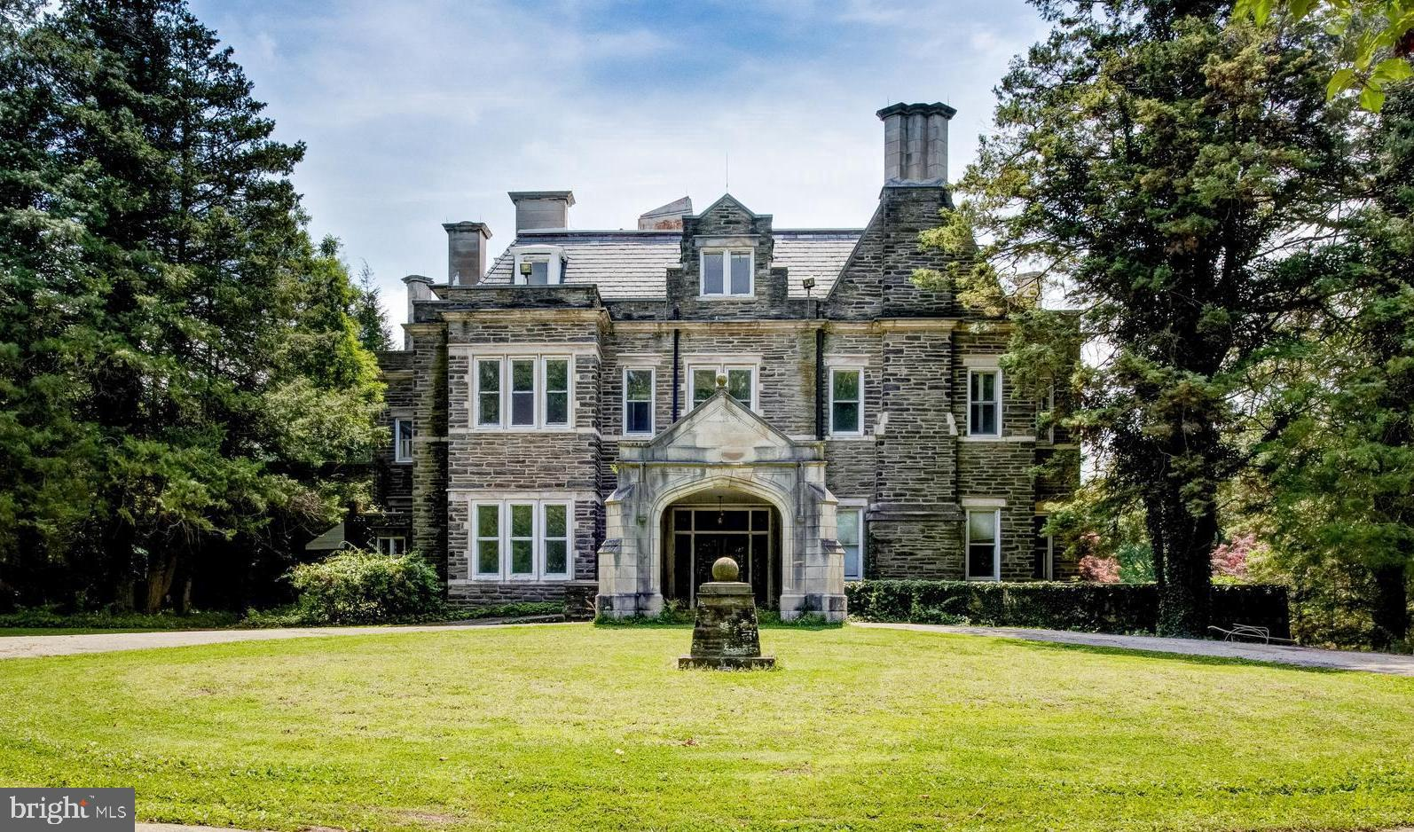Once a decade a residence like this comes to the market.  Greylock Mansion is a 25 room 16,500 sq ft, 8 bedroom, 4 full and 4 half bathroom mansion that sits on 7 acres of beautiful land bordering the 1,800 acres of Wissahickon Valley Park.  The tree lined winding driveway leads to a grand circle and covered entrance of this stone masterpiece originally built in 1909 by steel magnate Henry A. Laughlin.  The gorgeous exterior stone was quarried on site to construct this marvel.  The main house stands on a wide terrace with floor footprint sizes between 5,000 and 3,290 square including the walk out basement floor which has usable desirable ceiling heights.  The grand covered entrance opens to the gorgeous marble tiled  floors of the grand hall of the house and gives a clear span view to the other side of the house and it's giant entertaining patio.  The ceiling height, grandeur of the marble tile, the white marble stairs, and the windows everywhere show the pure class of this building and it's potential.  Luxuriously large living and dining rooms flank the exterior patio overlooking the sprawling 3-4 acre front lawn and the views provide great site of the Wissahickon Valley.  Many of these rooms still have original historic details that can and should be highlighted by her next owner.  The nearby carriage house is approximately 4500 sq ft with garage parking and it has an abundance of possibilities from private office space to in-law residence to work shop or more.  What is more good news is that the property taxes are reasonably low because of the conservancy easement on the property.  Enjoy the tree lined abundant land with taxes equivalent to a home much smaller in size.