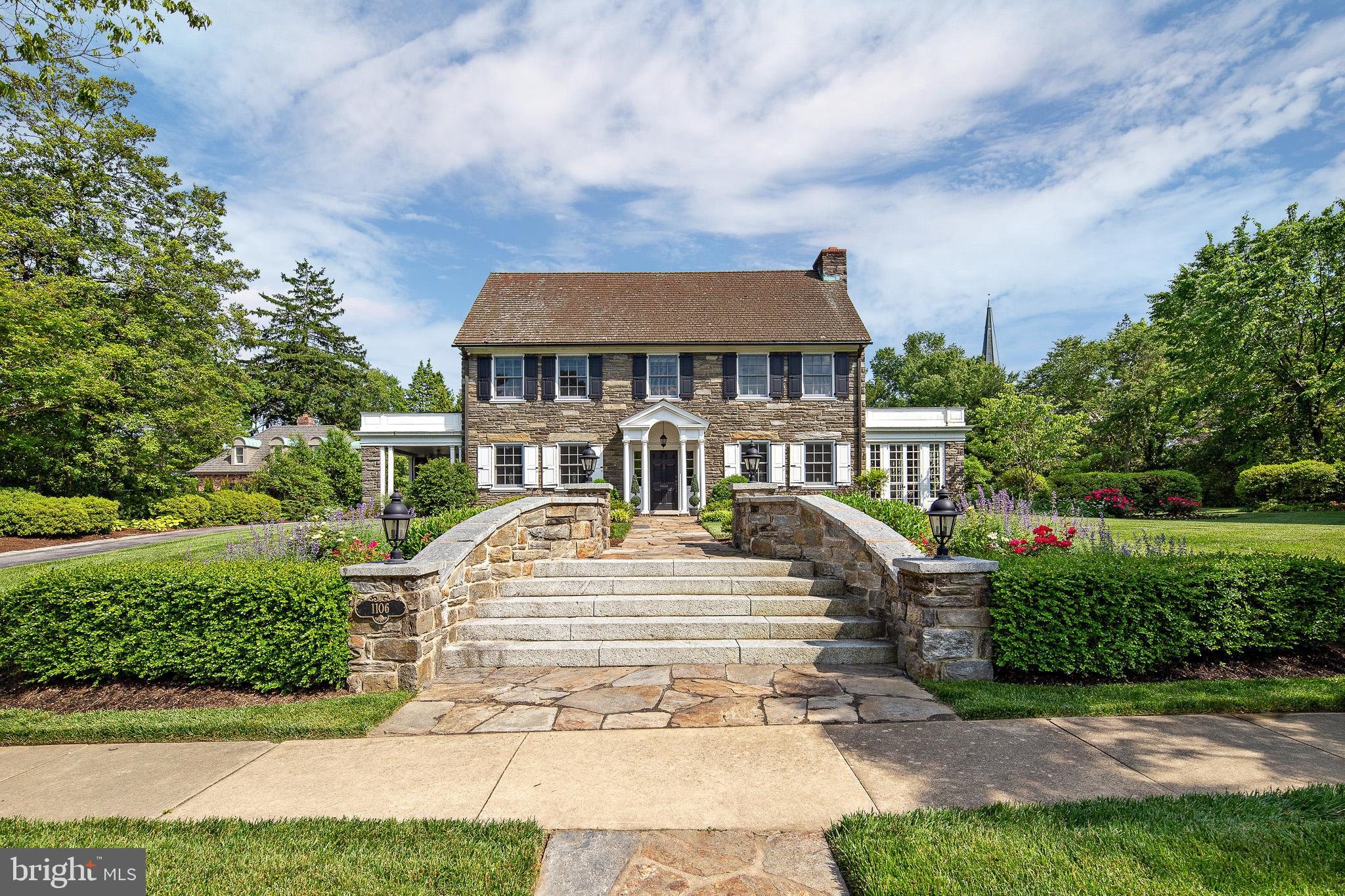 View the video online by following the link:  https://player.vimeo.com/video/426416309?autoplay=1. Stunning stone colonial has been fully renovated & meticulously maintained by the current owner. Elegant entry foyer w/marble flooring, turned staircase, wainscoting & powder rm. The formal living rm w/fireplace & moldings offers access to the enclosed sun porch.  Formal dining rm features wainscoting, crown molding & French doors leading to open side porch.  Gorgeous custom kitchen offers state of the art stainless appliances expansive center island, marble & granite counters. Eating area features a beautiful custom built-in buffet w/refrigerator & freezer drawers. Expanded family rm has an open flow from the kitchen & features high ceilings, gas fireplace, abundance of natural lighting & French doors leading to the expansive rear patio. Spacious master bedroom offers a wall of built-ins, walk-in closet, access to the rooftop deck & a luxurious master bath w/huge walk-in shower w/ tub.  Two additional en-suite bedrooms, & laundry rm.  The 3rd floor includes the spacious 4th bedroom complete w/private bath, storage rm & cedar closet.  Partially finished LL w/recreation rm, large bar & powder rm.  Lovely patio overlooks beautifully landscaped private yard.