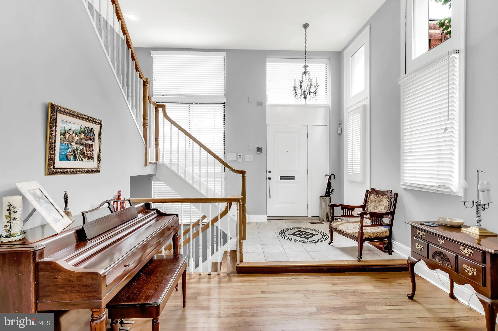 MUST SEE OLD CITY  SUN SPLASHED THREE BEDROOM PLUS DEN CORNER HOME WITH ONE DEEDED PARKING SPACE (included in the sale price). Step into an elegant and dramatic entrance way, where your eyes will gaze upon a stunning and well proportioned living room with CATHEDRAL CEILINGS. A magnificent staircase leads you to a beautiful and most efficiently laid out cook's kitchen with a BREAKFAST BAR and dining area. There is also a PICTURE PERFECT family room with FLOOR TO CEILING  windows and a fireplace. The third floor of this residence boasts TWO BEDROOMS  with a jack and Jill style  bath. Your master suite level you may never want to leave! Fantastic space. Large MARBLE and TILE bath, and your own PRIVATE DECK with stunning views. The lower  is completely finished, with a full bath and tons of ADDITIONAL STORAGE. This home on a COBBLE STONE street offers urban living at it's best, as well as fantastic CAFES and RESTAURANTS, easy access to I95, and just minutes from Cooper, Jefferson, and Pennsylvania Hospitals.