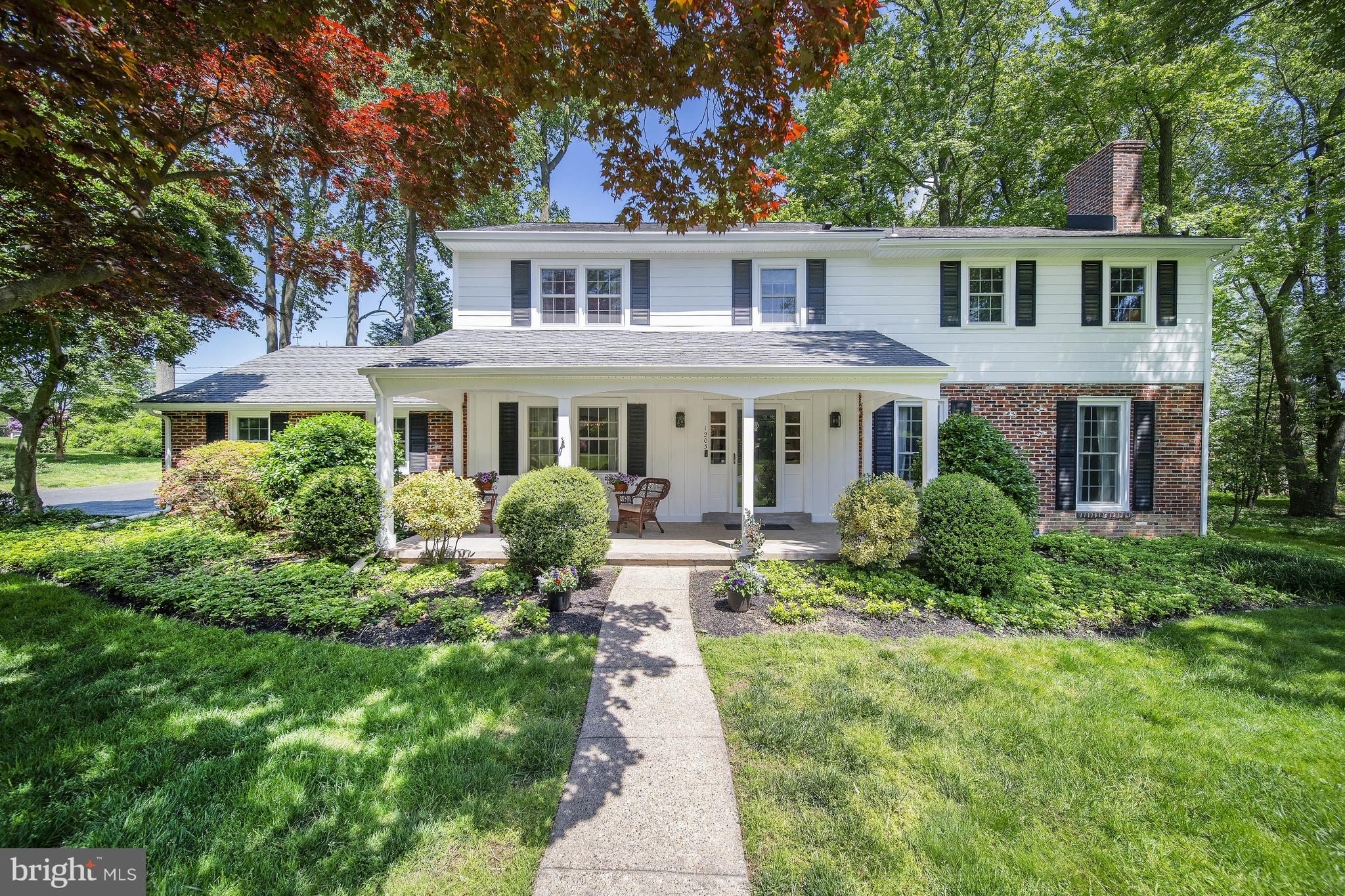 """Visit this home virtually: http://www.vht.com/434074646/IDXS - Proudly presenting 1203 Chadwick Road in N. Wilmington's premier neighborhood....""""WELSHIRE""""  This impressive home has recently had over $230,000 in custom renovations including a 14x10 first floor office/bedroom.  A welcoming 26x8 covered sitting porch and new James Hardie Plank siding greets you. As you enter the center hall foyer beautiful walnut floors through out and a sophisticated color palette follows.  The dining room features crown molding and a striking crystal Potter Barn chandelier. Two floor to ceiling windows and a wood burning fireplace and crown molding complete the living room which opens to the family room. A custom wall of built-ins in Polar Bear white, indirect lighting, and a french door that leads to the deck enhance the family room. This open floor plan concept from the family room to the kitchen is a special space where family and friends can gather to accommodate today's life style. A spectacular kitchen with its over sized island with plenty of storage and three eye catching pendent lights offers a huge space for family meals or entertaining. The abundance of white cabinets, Pelican white quartz counters and glass back splash set the stage for this high end kitchen. New six burner professional gas range, new Kitchen Aid refrigerator and dish washer along with a double oven complete the gourmet kitchen.  Conveniently off the kitchen the addition encompasses a mudroom with custom built-in cubbies which leads to the half bath (has a rough-in) access to the deck and the office/bedroom. Second floor features a spacious unsuite and an expanded luxurious bath. Amenities include a double sink and vanity in Carrera polished quartz and a stunning10x3 Carrera marble shower featuring dual shower fixtures. Three additional generously bedrooms and a renovated hall bath and laundry complete the upper level.2020 basement renovation includes a 25x22 media room with egress and a 12x12 work out ro"""