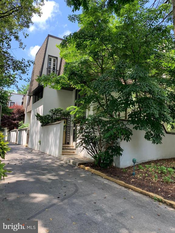 View the  VIDEO https://youtu.be/b4jxzsOBIeE  This spacious home is in move-in condition. This 1800+sf townhome offers a beautiful combination of space and light. Enter into the 2 story foyer with a coat closet and plenty of additional storage. The first floor offers a sunny open living/dining room area with new laminate flooring and sliders leading to the private patio.  There is a brand new kitchen with  LG appliances, a granite countertop. and high hat lighting. Also on this level is an updated powder room. A laundry room with a full-size washer/dryer and additional storage are also on this floor. The open second floor offers a great room with a wood-burning fireplace.  The two-story Atrium window provides natural light throughout the first and second floors. The third floor offers a spacious Master Bedroom with large closets and a Master Bathroom. The spacious second and third bedrooms have natural light and plenty of closet space.    There is a second full bath on the third floor with double sink vanity and a skylight.  The new LENNOX HVAC system was installed in 2019.   There are two parking spots. This beautiful townhome is within walking distance of Ardmore and Bryn Mawr including  Suburban Square, the farmers market,  movie theatre. library, retail shops,  restaurants, health and fitness centers,  and the Ardmore Train Station which offers SEPTA Regional and Amtrack train service.e.   Imagine yourself living here. Hurry to this amazing home in a great location that offers an urban lifestyle with suburban conveniences!