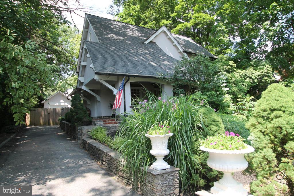 Located on the prestigious Main Line and in the award winning Lower Merion School District this home is a combination of old world charm and gorgeous upgrades on a private lot that offers a getaway from the hustle of the surrounding world; this center hall colonial  is entered from a large covered patio that is perfect for lazy afternoons or even large get togethers; inside to the left is a bright great room with a brick fireplace (non-functioning currently); the wraparound patio can be accessed by two separate doors directly from this room; on the right side of the entry hall is a formal dining room overlooking the front yard gardens and meandering brick walking path; the first floor features 9 foot ceilings, hardwood flooring, convenient closets, butler pantry, powder room and multiple access doors to the rear yard; a recently remodeled kitchen offers plenty of cabinet space, granite counter tops and newer appliances; the second floor features 3 bedrooms and two full baths - the master bedroom offers a beautiful remodeled master bath and two walk in closets; the second bedroom is flooded with light from 3 full sides of windows; a third level offers an additional bedroom, a full bath and a large bonus room; a full unfinished basement is the location for the laundry area with laundry tub and offers plenty of storage; the rear yard is an oasis from the world with a cozy patio area under every kids dream tree house, planting beds, mature trees and privacy all around; a one car detached garage allows for expansion; don't miss out on this one!