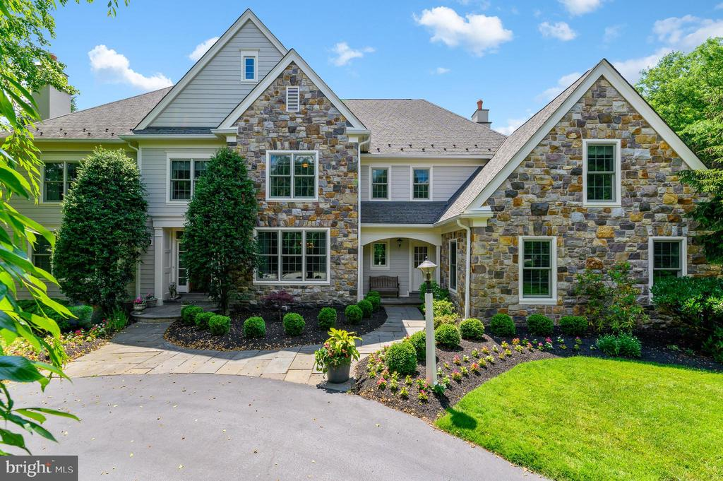 Welcome to 1460 Lanes End, Villanova PA, in the Pohlig built subdivision called Harriton Farm. If you are looking to be in the heart of Philadelphia~s Main Line, look no further. This gorgeous and impeccably maintained stone and hardie board 5 bedroom 7 bathroom gem has been updated with all new windows and all new hardie board this year to make it feel like a brand new home. The approach as you drive down to the cul de sac is very private, and beautifully landscaped around the circular drive. A flagstone walkway leads to the grand, front to back foyer with a dramatic staircase. On the left is the formal Living room with fireplace, on the right, the Dining room with wainscoting. Toward the back of the home, next to the Formal powder room, you~ll find the Study with built in bookcases and wainscoting.. Most of the living and gathering will take place in the large open kitchen with Thermador  and Subzero appliances, and a Butler~s pantry/wet bar  with built in cabinetry. The perfectly situated Morning room with vaulted ceiling overlooks the backyard. Open concept Family room with fireplace and coffered ceiling. Finishing out the first floor is the Mudroom with wainscoting, powder room,And three car heated garage with extra laundry area,  and wall storage organizer system. Just outside the front to back foyer, the large flagstone patio overlooks close to one acre of beautifully manicured lawn, which flows into the open space owned by the community. Mature trees and all day sun finish out the private back yard, an ideal spot to add a pool if you desire. Sonos sound system throughout the house and backyard and integrated wifi throughout the house. Irrigation system front and back keep the landscaping looking lush and green. The second floor landing leads you into the Master bedroom with a full sitting area, and two walk in closets. Full bath with Jacuzzi tub and double expanded vanities. Bedroom 2 with full bath, Bedroom 3 and 4 with Jack and Jill bathroom, Bedroom 5 wit