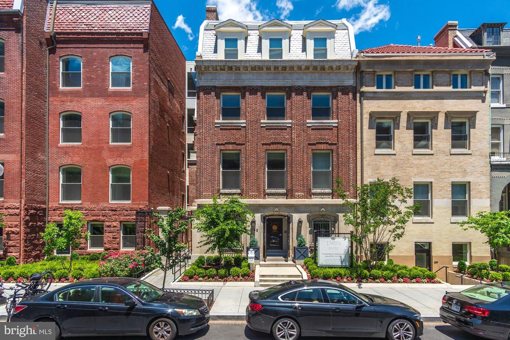 Only a handful remain at this gorgeous community!  #108 at The Historic Row at 1745N is a spacious 2 bedroom with 2 full baths, and an end residence, too!  Plus, it features an enormous PRIVATE TERRACE and a PARKING SPACE is included in its price!   Experience the finer details throughout including stainless steel appliances (gas cooking), wide-plank premium hardwood flooring, custom cabinetry and more. The Historic Row at 1745N offers a concierge, package room, bike room, and courtyard.  Find yourself relaxing in the courtyard, or your own private terrace.  Let's not forget the location: a tree-lined Dupont Circle street where Iron Gate, Tabard Inn are among the neighbors. Immediate delivery.   Historic charm with modern sensibilities:  The Historic Row at 1745N Dupont.
