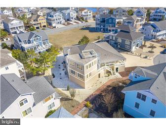 Visit this home virtually: https://my.matterport.com/show/?m=yWbskVkjGhQ - Tour this home virtually! https://my.matterport.com/show/?m=yWbskVkjGhQ - Custom Coastal Contemporary retreat is located on an 11,611 sq/ft lot in Cape Shores Lewes, Delaware (double lot).  It is on a cul-de-sac and just two homes from the beach. New stainless steel Bosch appliances, beautifully updated bathrooms with gorgeous tile, glass doors and fixtures.  5 Bedroom, 4.5 bath with open air, wrap-around decking on the second level. The addition privately houses a second Owner's retreat with rooftop deck access and dramatic panoramic views. Enjoy a fantastic view of the Lewes Beach fireworks. Come home from the beach and take a shower in one of two outdoor showers.  New lifetime transferrable warranty 50-year architectural roof. New landscaping.  Freshly painted interior and exterior.  Enjoy your days and nights on the wrap around porch. Community amenities include a pool, private pier for fishing and relaxation, and tennis courts. Walk or bike to the the Cape May Lewes Ferry Terminal and Cape Henlopen State Park. Enjoy spectacular fine dining in downtown Historic Lewes, just minutes away.  Seller is a licensed Real Estate Agent in the State of Delaware.
