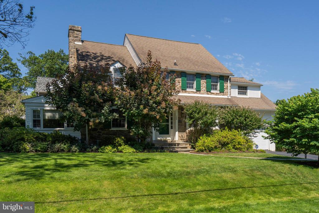 Be sure to watch the virtual tour of this stunning 4,890 square foot center hall colonial home in the College Park neighborhood of Bala Cynwyd. Located in the award winning Lower Merion School District, close to most major highways and a short distance to the Cynwyd Regional Rail station, downtown Bala, the Cynwyd Club with its beautiful pool and restaurant and Cynwyd Heritage Trail for walking, biking and quick access to Manyunk! Location aside, this is a fabulous home that has been lovingly and pristinely updated and maintained inside and out! Outside you can immediately appreciate the updates with gorgeous stone walls that have been recently repointed, newer replacement windows throughout, pristine flagstone patio and walkways, beautiful and mature landscaping with many specimen trees and plants and a vegetable garden! Inside you will find 5 nicely sized bedrooms and 3.5 updated bathrooms, recently updated heat and AC, a 2 car garage, a highly coveted mud room and a spacious finished basement! From the driveway, follow the handsome flagstone walkway which leads you to the brand new storm and front doors. Once inside, find gleaming hardwood floors and freshly painted walls. On the first floor you will find a sun lit dining room with bright bay of windows, a spacious living room with gas fireplace, a wall mounted flat screen tv, and built in shelving plus a family room or den off the living room perfect for a cozy reading room, a home office or a play space for little ones to enjoy. The kitchen is spacious with granite tops, stainless appliances, bar seating and a full eat-in space that is large enough for a full sized table and 4 chairs. On one side of the kitchen is the powder room and on the other is the ever important mud room area with built in cubbies, cabinets and two large custom closets with built in shelving for all your storage needs. This mud room area leads to the adjoining 2 car garage or the gorgeous flagstone patio. From this side patio, the current