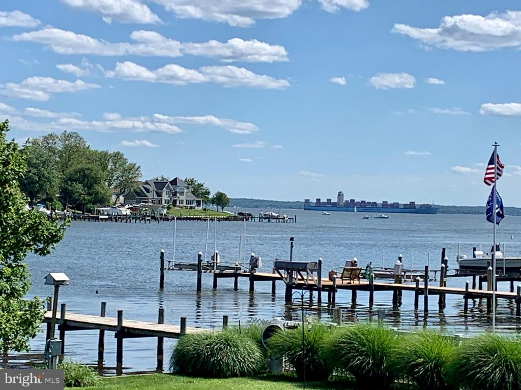 SHOWING WILL BEGIN ON FRIDAY JULY 10th at 9:00 AM........This Coastal Chic Colonial offers the perfect waterfront lifestyle; whether power boating out to a raft up, kayaking in the cove, fishing or crabbing, or setting sail on the Chesapeake Bay.   The entertaining  of friends and family are endless.  Once you open the front door, this home invites you in with views straight out to the water.  This beautiful home has 3 bedrooms and 3 full baths, an awesome over sized owners shower with jets and rain head.  The formal dinning room is big enough to host a large family event.  The family room is just off the kitchen and has a  cathedral ceilings and french doors out to the deck for great vista views.  7719 Iroquois Avenue is a gorgeous waterfront home in sought after Sparrows Point with sweeping panoramic views of the Chesapeake Bay.   The breathtaking setting is truly unsurpassed with English Garden style landscaping, incredible outdoor entertaining space and a private 150 foot  deep water pier.  Enjoy your morning coffee on your private Owners suite balcony while enjoys the sounds of the lapping water on the bulkhead.  Host a Friday afternoon Happy Hour and watch the cruise ships sail by.  Perfectly situated at the end of Iroquois Avenue for a private  feel surrounded by beautifully kept homes.  The home is located in a Magnate program school district and offers quick access to major commuting routes including I-695 and the Key Bridge.