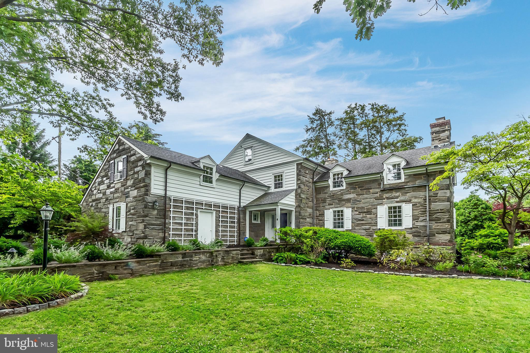 Rarely available renovated & updated corner lot 3825 SQ FT, 4 bedroom, 4.5 bath stately Stone Colonial home w/ 3 PA Fieldstone patios & walls, 2 fireplaces & porches, 1st floor office, sun room, finished walkout lower level, 2 car garage in tree lined & sought after Alapocas. Over $150,000 in new upgrades just done by the current homeowner. Only a job transfer makes this home available, just the 4th time to hit the market since being built in 1938. New upgrades: just gutted to the studs & enlarged Gourmet Cooks Kitchen w/ Professional Wolf 48 inch 6 burner/griddle gas range & DBL Convection oven & microwave, Sub Zero refrigerator, Asko dishwasher, 48 inch Best range hood, handmade custom Christiana Cabinetry wood cabinets & 6 seat island, custom Dark Walnut Oak Range Hood & Hardwood Floors, 2 Pantries, Crown & Chair Rail molding, handmade Hex Clay backsplash tile, Marble, Stainless Steel & Butcher Block countertops, DBL Bowl sink, commercial kitchen faucet, disposal (Insinkerator), LED recessed, under cabinet, pendant lighting & dimmers. Refinished Dark Walnut Oak hardwood floors throughout. PA Fieldstone patios, sitting wall & walkways connecting the 3 patios. Professional landscaping w/ landscape, tree, walkway & home lighting. High Efficiency gas forced air heat & central air (Trane), 2 zone heating system, furnace humidifier (Aprilaire), driveway & driveway drain system, sidewalk, insulated Carriage style garage doors & automated garage openers (Liftmaster). Light fixtures & ceiling fans. Professionally painted interior & exterior. Upgrades include: master bath (radiant floor heat, Calcutta, Statuario, Thassos, Carrara Marble sink, floor & wall tile, shower, tub, vanity, DBL sinks, Kohler fixtures, LED recessed & sconce lighting), 2nd full bath (radiant floor heat, Calcutta, Statuario, Thassos, Carrara Marble sink, floor & wall tile, shower, tub, vanity, sink, Kohler fixtures, LED recessed & sconce lighting), 3rd full bath (shower, tub, Kohler fixtures, ceramic 