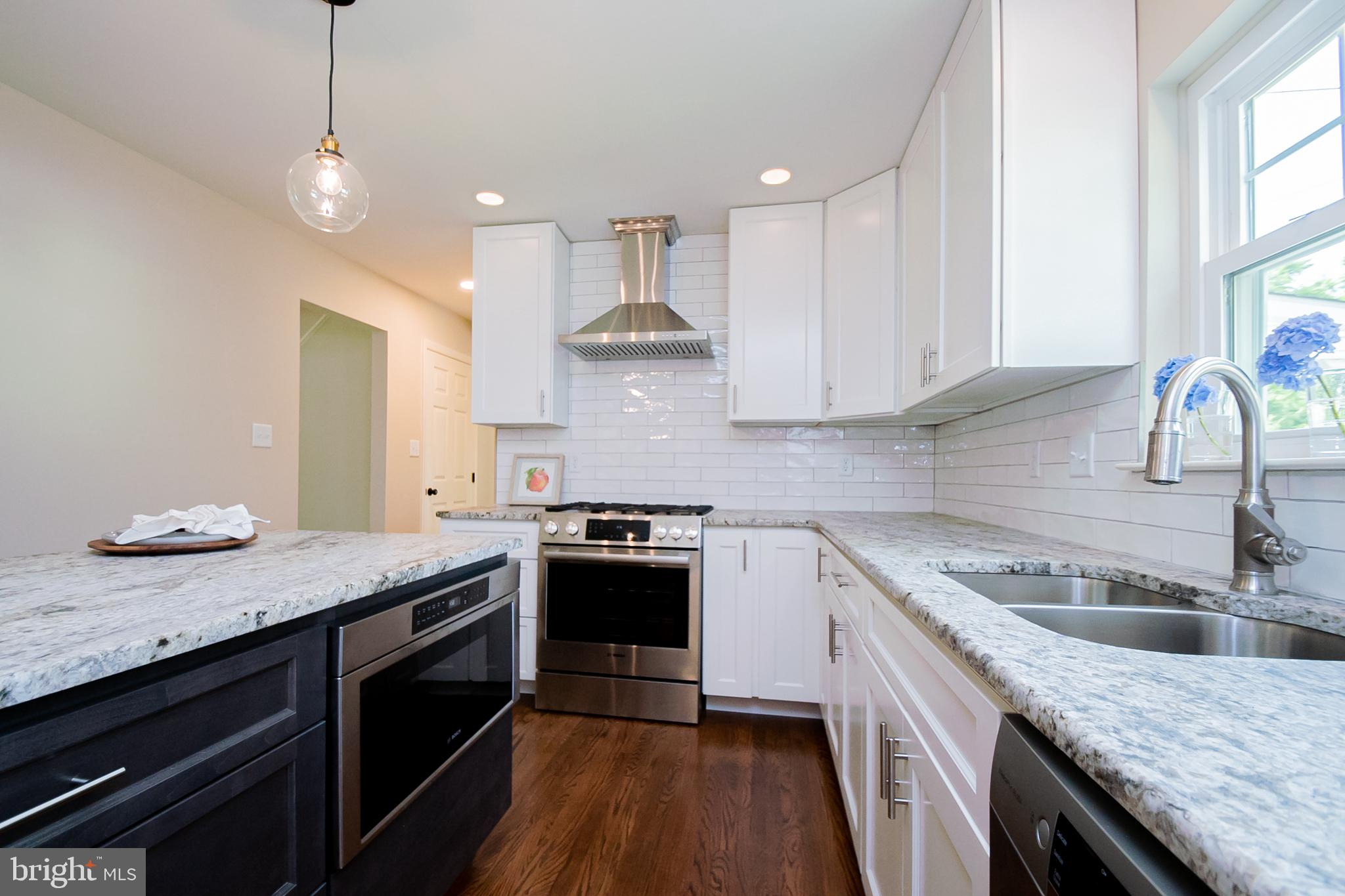 Visit this home virtually: http://www.vht.com/434078043/IDXS - Welcome home to 2413 Berwyn Road, a spectacular remodeled home nestled in the sought out neighborhood of Chalfonte. Located on a corner lot, this home provides great outdoor space. Upon entering the home, you will be greeted by new tiling throughout the foyer. The first level of this home offers a family room, living room, kitchen, half bathroom, laundry, and dining area. The kitchen offers brand new Wolff cabinets with soft close drawers, leather finished granite countertops, stainless steel appliances, stainless steel self venting range hood, new floors, new windows overlooking the backyard, and an island with ample seating for those gathering around during food preparation. The main floor also consists of refinished hardwood flooring and fresh paint. The second floor of this home offers four bedrooms and two full bathrooms. The hardwoods throughout the second floor have all been stained, and the walls have been freshly painted. The large primary bedroom has a completely remodeled shower. Enjoy countless activities in the half finished basement, made perfect for entertaining! You will also enjoy morning sunrises and evening sunsets on your back deck. The back deck is complete with dimmable lighting and a ceiling fan for seasonal enjoyment. The exterior of this home offers a professionally landscaped yard, and ample parking in the driveway. Make sure you schedule your tour today! Agent is related to seller.