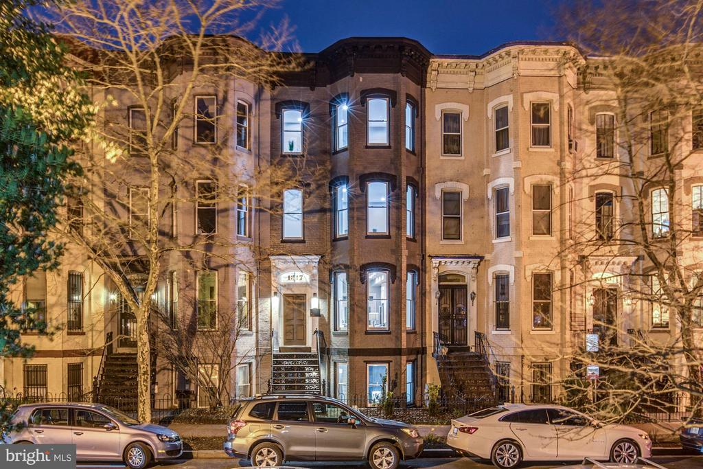 Luxurious living in Logan Circle.  This four level, 5 bedrooms, 4.5 bathrooms masterpiece sits less than a block away from the 14th street corridor.  English basement comes separately metered with it's own kitchen, living room, bedroom, bathroom, and washer/dryer connection.  The third floor is dedicated to a beautiful and spacious master bedroom with a huge walk in closet and a lovely bathroom with a plush soaking tub.  The 4th level has another master bedroom with a master bathroom, two additional bedrooms, bathroom, and washer/dryer.   The main level boasts and airy and spacious living room with an exquisite trey wall and large windows inviting lots of sunshine.  Kitchen comes equipped with stainless steel appliance, extended-height cabinetry, and lots of quartz counter space.  Walk out from the dining room to a beautiful walk out deck that overlooks a well manicured backyard and a paved enclosed two car driveway.  This home has it all.  Come and see!