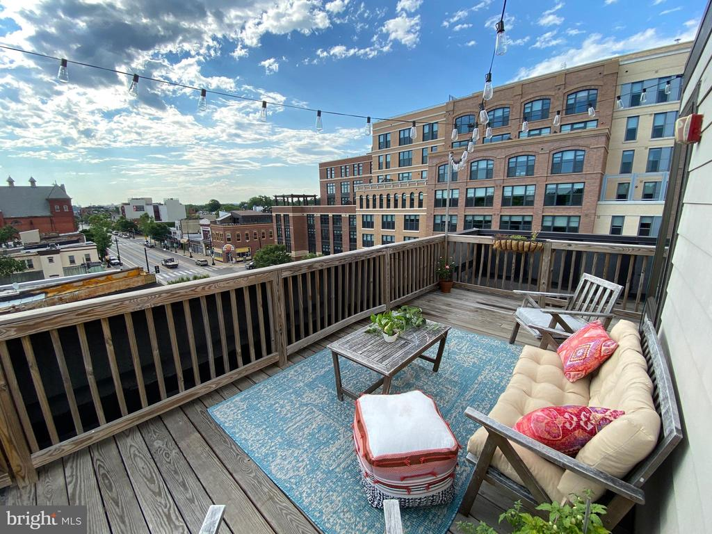 Enjoy this rare top floor penthouse with walk up rooftop deck all to yourself! Condo was built in 2016 and has street-front views of the H Street scene, and faces south through a large bay window for great all-day light.  Three condo units sit atop the Dio Wine Bar - grab a bottle of wine and a cheese plate and bring it up to your PRIVATE roof deck (no other units have access to the roof) while taking in the city views, including the Washington Monument.  The two bedrooms and two baths are at the back of the unit, offering a respite from the activity on H Street. Features include: wide-plank hardwood, quality finishes, washer/dryer in unit, high ceilings, and a super-low condo fee! A deeded parking space is included in the price. Huge Amazon Go is opening across the street! Whole Foods and CVS are three blocks, walk to Union Station, and this central spot on H Street allows you walk to all the amenities up and down the corridor.