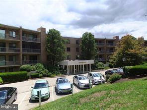 """Welcome to the South Terrace Building at """"Oak Hill Condominiums"""", Penn Valley, Pa. This home is located on the top (4TH) floor just a few steps to the elevator and parking lot. This home boasts wall to wall carpets, and great closet space. There is a coat closet in the foyer. The large living and dining area overlook the large sun drenched balcony.  There is  a large bedroom, bath and walk in closet. Kitchen features lots of cabinets, refrigerator, and more.  Condo monthly includes, hot and cold water, sewer, trash and snow removal, exterior maintenance and common area insurance. landscaping and parking. 2 small pets permitted up to 25 pounds, balcony electric grills are permitted. Pool, tennis, pickle ball, basketball, and gym available. Club house facility available for rental. Great Lower Merion Township Schools, Minutes to center city via Public transportation, #44 bus at front door. xways and nearby train. Convenient Suburban Square, shopping and restaurants all nearby. Major community renovation underway  Special assessment #1   $74.94 per month for 84 monthly payments from September 1, 2018, 2nd special assessment 129.04 for 24 monthly payments from  February 1, 2020<  Due to recent building fire, seller disclosure is being revised."""