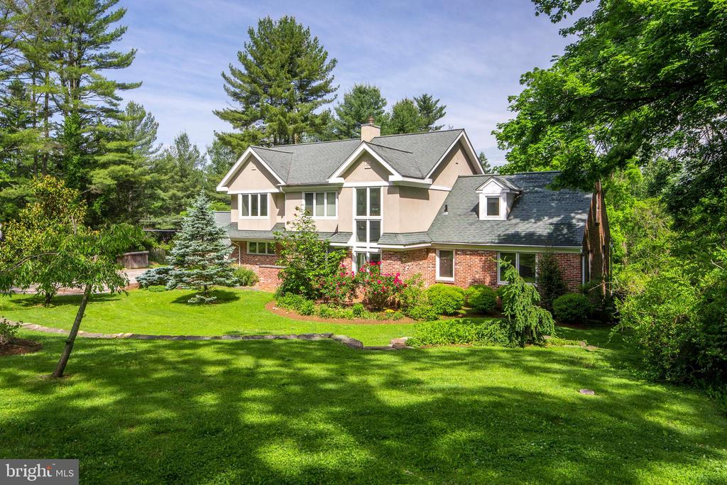 Understated and stealthy Euro contemporary masterpiece in Villanova. This traditional brick raised ranch home was completely gutted and expanded in 2008 by local boutique builder Tom Guy. Meticulously designed and featuring ultra-high quality materials throughout, this 6 bedroom 5.5 bath home has an open floor plan with first floor in-law suite; sophisticated gourmet kitchen with custom cabinetry and stainless appliances open to dining area with access to rear deck overlooking large private rear yard. Two living/family spaces separated by a dramatic two-sided fireplace and custom built-in shelving are open to the kitchen as well and look to 2 story foyer with floating stair and massive window at front of house. First floor in-law suite features living room with wet bar and microwave, separate bedroom, private bath and laundry closet with wash tub. Other first floor amenities include custom maple floors with slate boarders, powder room with waterfall sink, custom kitchen pantry, built-in desk area, closets and rear hall to driveway and garage. Upper level has second laundry,  4 bedrooms and 3 full baths including a master suite with 2 walk-in closets, sumptuous bath and sitting room with private deck. Lower level includes full bedroom, bath, theater room, storage/mechanical room and mud room leading to stairs to rear yard. Five zone HVAC; European style materials, built-ins, solid-wood doors, contemporary bath fixtures and wall coverings create a clean, stylish feel that you rarely see in this market. All located within seconds from Philadelphia Country Club, Conshohocken highway interchange and corporate center. All this with taxes under $20K!!