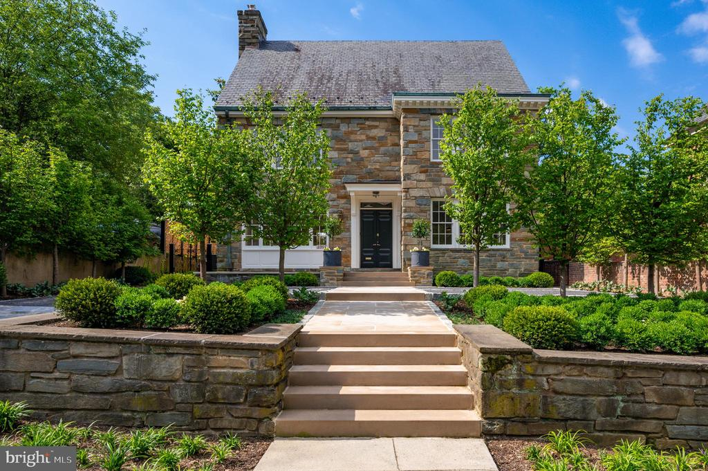 "Located in the historical neighborhood of Kalorama; this detached stone 6BR/6.5BA home occupies a premium lot with landscape design by renowned landscape architect Ben Page. The residence has been completely renovated - architect Christian Zapatka - and original features have been artfully restored. The grand main level entry with marble vestibule, white oak floors, powder room, and coat closet serves all areas creating fantastic flow. The bright living room spans the entire length of the house and boasts intricate crown mouldings and original marble fireplace and Venetian mirror. The formal dining room connects to the kitchen through a butler's pantry with calacatta gold marble counters and tiled wall,  additional Bosch dishwasher, and 48"" SubZero custom quilted paneled refrigerator/freezer. The eat-in gourmet kitchen features an 8-burner double oven Wolf gas range, Bosch dishwasher, and calacatta gold counters with bar seating for four. The second and third levels of the home feature 5 bedrooms and 5 baths and are accessed by a beautiful curved stair with original brass and metal railing. All bedrooms have en-suite Waterworks baths with Italian carrara marble and heated floors. The lower level contains a 6th bedroom with separate access and 6th full bath, family room, wet bar with a third Bosch dishwasher and SubZero wine/refrigerator/freezer, and large laundry room with island and XL Electrolux washer/dryer. The rear terrace and garden is accessed through 3 sets of french doors on the back of the home. The granite parking court and driveway allows for off-street parking for 4 cars. Vivint security system w/ outdoor HD night-vision cameras & interior motion sensors. Walk to DuPont, Georgetown, Adams Morgan."
