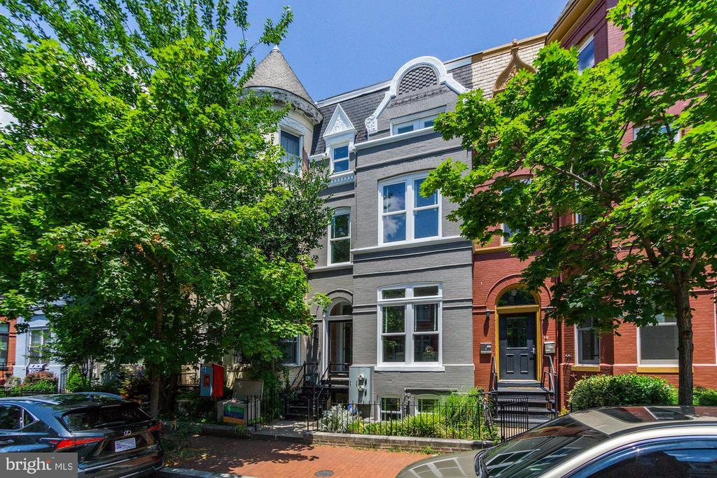 Fully renovated in 2010 with updates since, this stunning 4 story historic  row is one of the largest homes on the desirable Westminster St NW. Walk through your double door vestibule into your modern, open floor plan living and dining space with table space for 10-12. Newly refinished white oak floors throughout with fully wired home audio system on all three levels, NEST thermostats connected to dual zone HVAC. The kitchen is perfect for entertaining, measuring 25' x 12', with a six burner gas range with griddle, double oven with commercial hood including heat lamps, and massive separate refrigerator and freezer measuring 34~ wide each. Seating for 4+ on the island and still room for a breakfast table. Through the back door is your 18.8' x 18.7' parking pad. The second floor includes the first primary suite facing south on Westminster. En suite bath has a large full wall closet with pocket doors and ELFA customized shelving which is found in all of the bedroom closets. Rounding out the second floor is a hall bath with soaking tub and a private balcony off the second of three bedrooms. The third floor is made up of the second primary suite with two double door closets, dual vanity bath, separate soaking tub and multi-head frame less glass shower.  A powder room and wet bar that includes a wine fridge, prep sink and ice maker is also found on the third floor at the entrance to a deck measuring 14' x 24.5' which is perfect for grilling and alfresco dining. From there ascend a spiral stair case to a spacious rooftop sundeck measuring 18.8' x 24' with one of the best 360 degree views of DC including the Washington Monument. Above grade outdoor space totals over 800 sq.ft. Lower level is a separate 2bed/1bath unit with CofO currently rented for $2500/mth.  Steps to Westminster children's park and blocks to restaurants and retail in Shaw and Logan including Giant, Trader Joe's and the  Whole Foods at Florida and W St NW.  This will only be shown by appointment with listing agent and 24hrs notice.**Masks are mandatory for all guests.**
