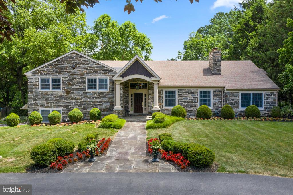 Welcome to 1111 Robin Road in Gladwyne, PA. This 4 bedroom home with in-ground swimming pool sits in the heart of Philadelphia's coveted Main Line, just a few houses away from Philadelphia Country Club's breathtaking golf course. The exterior is stone and stucco, with well manicured grounds, and an extended horseshoe driveway for loads of off street parking. A major whole house renovation was done in 2008 to expand this to a spacious 4 bedroom 4.5 bath house with two home offices and Brazilian Cherry hardwood floors throughout. The flagstone walkway to portico entrance welcome guests into a two story entrance foyer with custom wrought iron and wood railings. To the right, the large living room has a wood burning fireplace and custom cabinetry. The ~wow factor~ hits you as you enter the open concept kitchen with GE Monogram appliances, Fisher Paykel dish drawers, instant hot water, and granite countertops with two sinks - both with disposals and under cabinet lighting. Spacious breakfast area and a Great Room that is ideal for large gatherings or to watch the game. The Great Room has a gas fireplace, wet bar, wine cooler and beverage fridge with icemaker, and home theater with a custom audio system serving 7 rooms and the patio. Off of the spacious living area is a large dining room with french doors, a large grand office, and powder room. A short flight of stairs down is the family room/playroom with full bath and access to the heated Sylvan swimming pool with Travertine decking. The oversized two car garage makes it easy to pull right in and unload your car while being sheltered from the elements. Just a few more steps down, there is plenty of unfinished storage in the basement. Upstairs on the next level is an en suite bedroom, that can serve as a 2nd main bedroom suite. Two additional bedrooms share a hall bath with double sinks, linen closet and laundry room. The Main Bedroom en suite with sitting room, 2 walk-in closets with custom closet systems, a linen closet and 2nd home office with back stairs on the top floor. Additional storage on this level makes a great spot to store luggage or things you want easily accessible. Additional features make this home special, including 3 Zone HVAC with programmed controls, Anderson windows and patio doors, double crown molding in LR, office, DR, and kitchen, Hunter fans in all bedrooms, office, sitting room, and downstairs FR/playroom, Casablanca fan in GR, all lights on dimmers, fans on wall switch, and drop down stairs to attic. The prime location is convenient to the city and the airport with easy access to I-76, 476, the PA Turnpike and Route 23. Walkable private streets make this an ideal park-like setting if you enjoy biking, running or walking.