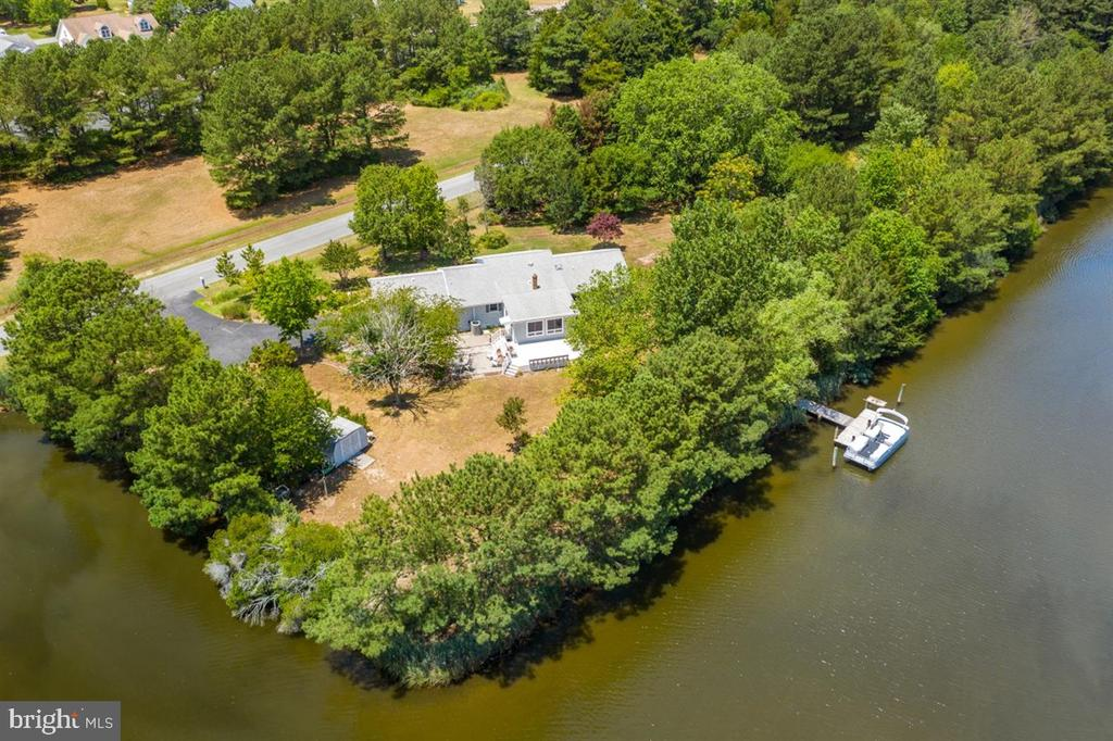 WATERFRONT PRIVATE PARADISE, Incredible rare find with 900+ feet of Waterfront nestled on 3.22 Acres in secluded Hidden Harbor!  Beautiful setting with views of Grey~s Creek off the Assawoman Bay.   This property is the perfect home for those looking for waterfront privacy.  Deep Water off the Pier/Dock.  This Lovely Large Rancher has an over sized 2 Car Attached Side Loading Garage with storage above.   Amazing views from most points in this 3 Bedroom, 2 Full Bath Rancher with Formal Living and Dining and 2 Family Rooms.  Complete Relaxation on the Waterfront Deck in the serenity of your own retreat! This large lot is perfect for your outdoor oasis and just walk out back to your private dock/pier.   Offering a plethora of fun from crabbing, fishing, kayaking, or simply watching the Blue Herons.  If privacy and waterside living is what enjoy, this is a must see.   All within a few minutes of the beautiful beaches of Fenwick Island, Ocean City and Golf.  2 Miles to Harris Teeter,  No HOA Fees.  , Live where you Play !  Professional pictures coming soon.  Call me for a Private Showing.  Heatpump (HVAC) with Backup Baseboard Heat too !