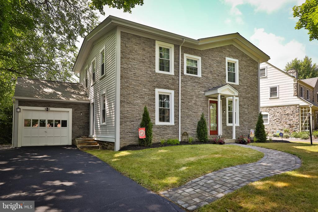 Welcome, Home. This home is absolutely stunning, the care in homeownership is everywhere you look. Plus the location is amazing. Walking distance to Whole Foods, shopping, regional rail, Narberth Park, Suburban Square and so much more. Pull up to your completely renovated front exterior with all new Stone Front, front door, hardscape, paver walkway, covered porch. When you head inside you will fall in love with all the charm.~ Once inside there is a spacious front room, that can be a playroom, office, additional TV room, options are endless, through there you enter into the open family room that looks into the bright spacious dining room. This space is wonderful and all open, bright, freshly painted with hardwood flooring throughout. From the Dining Room head into your eat-in kitchen with breakfast bar, all updated kitchen cabinets, quartz countertops, stainless steel appliances, and a sliding door out to your deck and large private fenced in backyard. Finishing off this floor is two large storage closets along with a half bath. Head upstairs to the second floor. The master bedroom with a large closet, and a full bathroom. All updated with new lighting, vanity, and both the bathroom and bedroom are freshly painted, hardwood flooring throughout the second floor. There are three additional bedrooms all spacious in size with larger closets. Additionally, an updated hall bath with linen closet rounds off this floor. Head down to your basement, that can easily be made into additional space if needed, it is all open and very clean. Outside is the pull up one car garage along with the rear garden shed for additional storage. Don't wait on seeing this home. It is ready for you to make your own.~