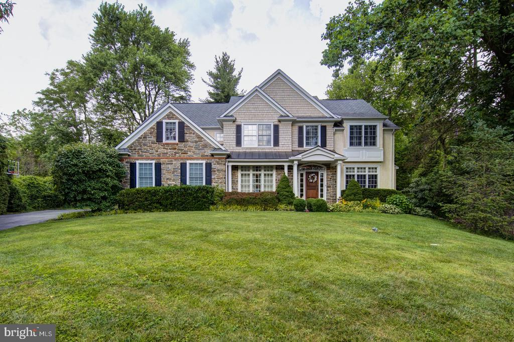 Gorgeous 14-year old custom built stone and stucco colonial located on a quiet street in the heart of Paoli.  This impressive property boasts five bedrooms, four full and two-half bathrooms, 4,360 square feet of luxurious above grade living space, a three-car side entry garage, and a level .60-acre private lot.  A flagstone walkway leads to covered front entrance portico with standing seam metal roof and attractive columns.  Step inside to an open center hall foyer with gleaming hardwood floors and a flared oak staircase with direct set balusters and matching oak rail.  A formal living room with gas fireplace and custom mantel is located to the right of the foyer.  On the opposite side is a spacious dining room with extensive moldings and a cased opening leading to a wet bar with sink, wine chiller, and custom cabinetry.  The gourmet kitchen is sure to please offering handsome cabinetry with crown molding, stainless steel appliances, granite countertop, pot filler, tile backsplash, and a large center island with farm sink, dishwasher, and overhang seating for four.  Just beyond the kitchen is a large family room with vaulted ceiling, Palladian window, gas fireplace, and custom built-ins.  Other first floor features include a breakfast room with access to a rear flagstone patio, office, two half bathrooms, a rear staircase, and inside access to the 3-car side entry garage.  Heading upstairs, the master bedroom suite includes a sitting room, vaulted ceiling, plantation blinds, his/her walk-in closets with custom organization systems, and a spa like bathroom with two vanities, soaking tub, shower with floor to ceiling tile, tile floor, and separate water closet.  Four large secondary bedrooms, two with en-suite bathrooms, a full hall bathroom, and a convenient laundry room are also located on the upper level.  The unfinished basement offers tons of storage, has a 3-piece rough in for future bathroom, and a walk-up egress exit should the next owner want to finished the 