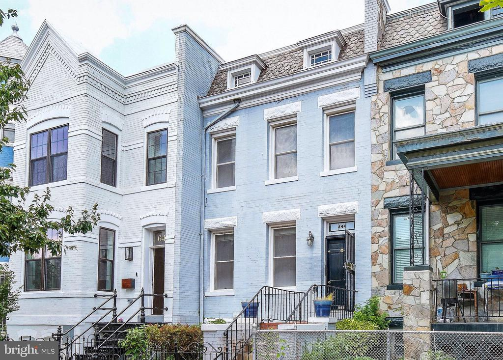 Welcome to your new home in the Capitol Hill Historic District!  Beautiful and spacious 4BR/2.5BA three-level rowhouse is close to Union Station, the US Capitol, and H Street - only 0.3mi from Whole Foods!  Main house consists of two levels with 3BR/1.5BA, hardwood floors, exposed brick, high ceilings, wood-burning fireplace, recessed lights, updated kitchen, large elevated private back deck and fenced back yard. The separate lower-level basement has abundant natural light and is a large and fully finished 1BR/1BA with open LR/DR plus a den, full kitchen, and full-size W/D .  This is a legal rental unit with private front and rear entrances and most recently rented for $2,100/mo.  This is your opportunity to own on the Hill and have your tenants offset your mortgage!