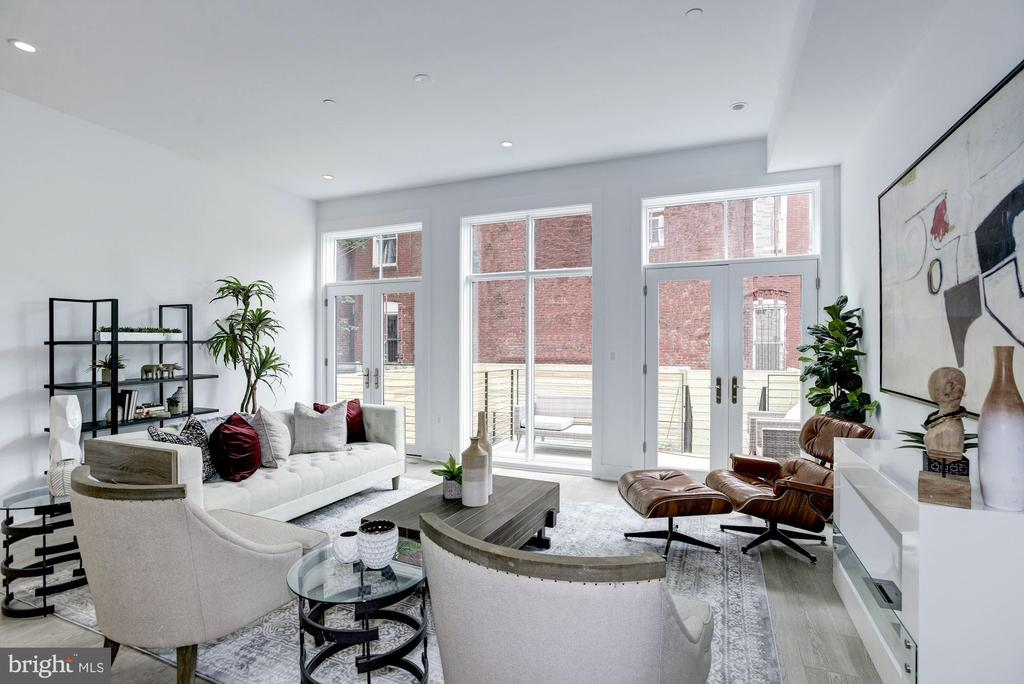 OPEN HOUSE! SUNDAY,  AUG 9th; 1-4P! A DREAM HOME for how we all want to live today. IMPRESSIVELY BUILT, THOUGHTFULLY DESIGNED, the Maisonette is a newly constructed boutique building by the talented team of Eric Hirshfield of INTOWN Development and Jim Foster of Arcadia Design. Residence B features three bedrooms, three-and-a-half baths, plus den, creatively laid out over a large open floor plan with 1,869 square feet. Floor to ceiling windows that lead to a private balcony and garden adjacent to a magnificent gourmet kitchen with wine refrigerator flood the main level~s open concept living space with natural light. A spacious dining room organically flows into a wonderful living room with high ceilings throughout. One of the many unique features of this residence is the ~lock-off suite~ with separate entrance, kitchenette and full bathroom on its own separate level, conveniently tucked away as to not impede on the privacy of your own home. Perfect for a home office with its own separate entrance or to use as a rental to generate income.THE DETAILS: These residences feature charcoal matte porcelain floor tiles upon entry to the foyer. Luxury living with custom built-ins, Possini pendant lighting and wall sconces, Electrolux white front load washer/dryer, and Virginia Mill Works cashmere gray oak hardwood floors. Beautiful and spacious kitchens with Mont Blanc marble countertops, Bosch stainless steel appliances, gas range, and Summit beverage cooler makes for the perfect space to entertain. Bathrooms feature high gloss vanities, brushed nickel LED lighting, freestanding soaking tubs, polished and brushed marble shower wall tile, and polished chrome fixtures. These homes are loaded with Smart Home Tech with Smart doorbell, pre-wiring for surround sound and home automation, surveillance cameras, and Nest thermostats. Situated just East of Logan Circle on the quiet, tree-lined street of P St NW, the Maisonette is located in the heart of the city and just steps to all the conveniences we all want, yet tucked away from the hustle and bustle. New quality construction, thoughtful design, gorgeous outdoor space, separate home office, serene spa bathrooms, plentiful storage, massive square footage and high ceilings ~ this truly is your DREAM HOME for 2020.