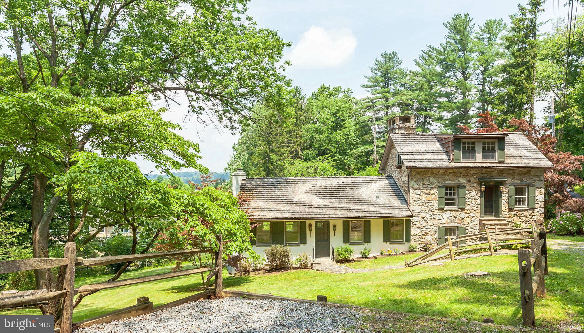 Enchanting, renovated Chester Springs stone cottage on .72 acres, with original structure dating back to the mid-1800's, positively exudes character and charm - two Dutch doors, two wood burning fireplaces, two winding staircases, gorgeous exposed stone, cedar shake roof, claw foot soaking tub, hardwood and slate floors and impeccable hardware throughout.~ This idyllic property is located less than 2 miles from the PA Turnpike, amid plenty of proximate shopping, and is a quick 10 minute drive to the Exton Amtrak station, with direct routes to Philadelphia and NYC, making commutes in and out of either city a snap.~ This unique home has a wonderfully flexible and adaptable floor plan.~ Take the lower entrance into the main level front hall, past the coat closet, into the lovely living room with wood burning fireplace, space for both living room and formal dining room furnishings, built-in shelves and cabinets and bay window that provides beautiful natural light. Just down the hall are a main level bedroom and full bath with claw foot tub, making one level living a wonderful option.~ There is also a highly functional laundry room, along with a generous pantry / storage closet. The main level hallway then leads to a uniquely preserved, incredible stone archway that was the original cook's fireplace, and just on the other side is the updated eat-in kitchen.~ Slate floors, Corian counters and island, gas range, lots of beautiful cherry cabinets, another pantry and more built-ins add to the aesthetic appeal of this highly functional kitchen, with plenty of room for a dining table.~ ~Ascend the turned stair to the next level of the home, which is the bright and spacious home office with dedicated Dutch door entrance, wood burning fireplace and built-in shelving. This space makes working from home a complete pleasure, and is an enviable venue for all your Zoom meetings!~ This level could also be well utilized as a play room, family room or third bedroom.~ Another turned stai