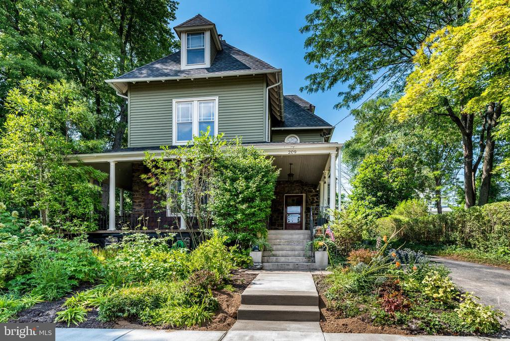 Historic charm blended with modern details in the heart of Narberth makes this a rare gem! Walk through the lovely front garden to the welcoming wrap-around front porch into this 7-bedroomVictorian home. Stepping into the foyer, it's hard to miss the beautiful hardwood floors and the grand three-story stairway. The foyer is open to the high-ceilinged living room with stone fireplace and bay window, large family room, dining room with deep windowsills and an updated kitchen with back stairs to the second floor. Off the kitchen is a mud room with a powder room, laundry hook-up and baking area with a second sink. The back doors lead to a wooden deck that extends the width of the house and steps down to a patio and flat back yard with flowing garden walks and a detached two-car garage. The second floor has 4 bedrooms and 2 full bathrooms that have been updated with new floors and toilets,and a new sink and original tile in the hall bath. The third floor has 3 bedrooms and a storage room that has been partially plumbed for a potential third-floor bathroom. Details abound in this home; from the cherry inlay floors to unique circular and eyebrow windows, to a room with 8 walls! This family-friendly home comes with modern renovations, including central air, a new roof in 2013, newer plumbing, and new electrical. Come see, because it won't last! This south Narberth house is located in the award-winning Lower Merion School District in easy walking distance to the charming town of Narberth with its restaurants, shopping, library, movie theater, and train station. Travel by regional rail to Amtrak Station (14min) and to Center City (20min)  From Amtrak Station take a free shuttle to all UPenn, UPHS & CHOP facilities.