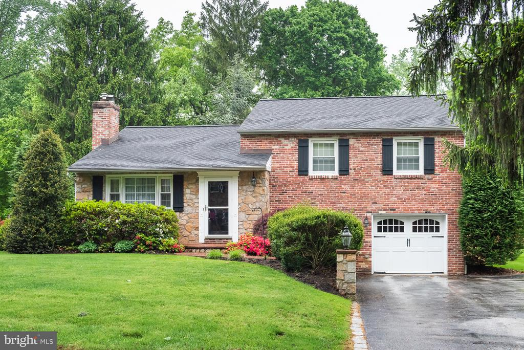 Welcome to 321 Spencer Road, a well kept home on a quiet tree lined street in a wonderful Devon neighborhood! The first floor features a living room with gas fireplace, dining area with built-ins & newer kitchen boasting gas range, new stainless steel refrigerator (2018), garbage disposal (2017) & newer stainless steel dishwasher and under cabinet lighting. The 2nd floor has a master bedroom with its own half bath as well as 2 more bedrooms each served by a hall bathroom. The lower level has a family room that is currently set up as an office or work area with built-ins as well as a laundry room featuring new washer/dryer (2019), laundry sink and access out back. There is also an unfinished basement that is perfect for storage with a new sump pump (2019), newer furnace/boiler (2016) & new hot water heater (2018). The fenced-in back yard is flat and open yet it affords privacy as you dine or entertain on the EP Henry patio with automatic awning. Don~t miss the upgrades in the front as you will be delighted by the expanded driveway & lighting along the retaining wall and steps. Other amenities include lots of hardwood floors, central A/C, attached 1-car garage and close proximity to 202, 76 & Rt 30. Spencer Road hosts block parties, progressive dinners and other social neighborhood activities that you can enjoy. All of this in the highly acclaimed Tredyffrin/Easttown School District!