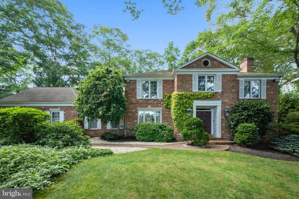 Set perfectly on a quiet cul-de-sac in sought after Northside Haverford, this elegant brick colonial will draw you in at first glance. The Belgian block lined driveway and brick walkway through the manicured garden leads you to the double front door, which opens into a two story foyer, featuring a dramatic curved staircase. Hardwood floors, beautiful crown moldings and sunlit spaces that open to outdoor living highlight this home. The spacious living room, with a wood burning fireplace and French doors opening to a covered porch, flows into the Family Room featuring a fireplace with brick accent wall, wood beamed ceiling and wet bar for entertaining, as well as sliding glass doors opening onto a brick patio. The spacious dining room is perfect for entertaining, with views of mature plantings through a picture window. The dining room opens into a formal library/office with floor to ceiling built-in bookshelves and storage, and two Palladium windows allowing sunlight to stream in. The dining room opens to the well-appointed eat-in kitchen, with handmade French tile floors, and a sunlit breakfast room with sliding glass doors opening to the patio for outdoor barbecue and dining.  A powder room, laundry room with storage, and entrance to the attached two car garage complete this level.  Ascend the stairs to the sumptuous Master Suite with oversized marble bath, including jetted tub, steam shower, dual sinks, and dressing area with walk-in closets and glass French doors opening onto a private balcony, perfect for morning coffee overlooking the lush green views. Three additional generous bedrooms with ample closets share an updated hall bath with soaking tub. There is a finished lower level, with great space for a home office, game room with movie screen, and gym, along with plenty of storage. With a whole-house generator, and award-winning Lower Merion Schools this sunlit beauty is the one you've been waiting for.