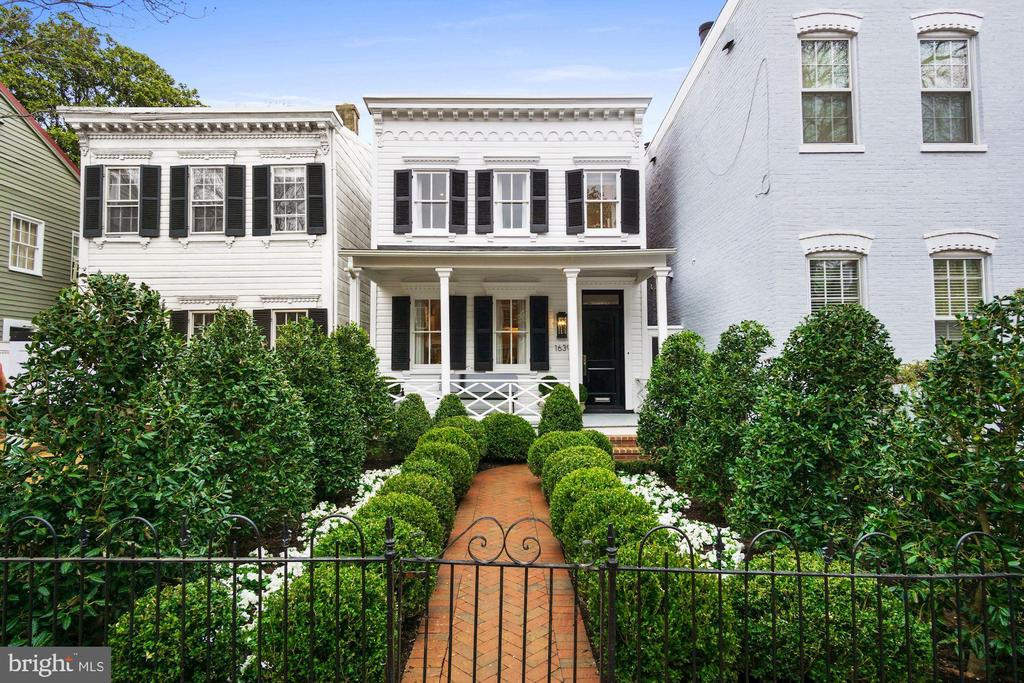 NEW PRICE! Akseizer Residential does it again with this immaculate Georgetown renovation. A fully-detached colonial home circa 1908 has been reimagined for modern living with no detail spared. The lush gated garden with herringbone brick walkway leads to a charming covered front porch and into an expansive parlor. White oak herringbone wood floors flow throughout the open living space including the Living Room with a marble gas fireplace flanked by custom built-ins, Dining Room, and eat-in Kitchen with waterfall edge island, top-of-the-line Thermador appliances, Waterworks fixtures, and walkout to a professionally-landscaped private rear garden. 4 Bedrooms offer generous storage, and 3.5 Bathrooms feature gorgeous Waterworks fixtures and marble finishes. Added convenience with laundry on both the upper and lower levels. Smart home features include wifi-connected integrated audio, video, lighting, thermostats, security, appliances, and more. All complete with gated parking in a prime Georgetown location.