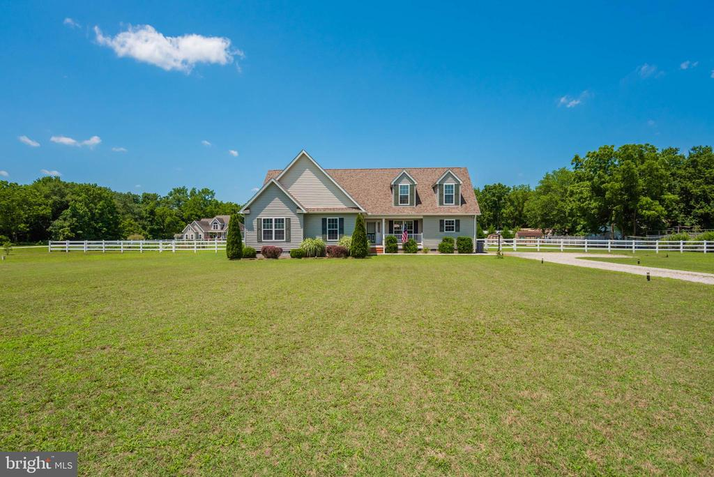 Rural Living at it's best in this 2012 built home on 2.35 acres with huge vinyl fenced yard for kids, garden and animals.  Enjoy Country living but still only 15 minutes to the beaches and 1 mile to the DE line.  This home is made to expand with a 2nd floor and two rooms that could be finished to add a Flex room and a bonus Room.   This will be a great family or retirement home for someone looking to live in a quiet area but yet close to everything.  The first floor offers 3 bedrooms (to include master bedroom) laundry room, powder room and Great room with a Pellet Stove which keeps you warm in the Winter.  Granite counters in kitchen and floors throughout the first floor are engineered and almost new.  2 Sheds  and tons of parking.  Room to  add a garage if needed. Above ground pool conveys too!  Enjoy outside living on your deck and in evening the Firepit!