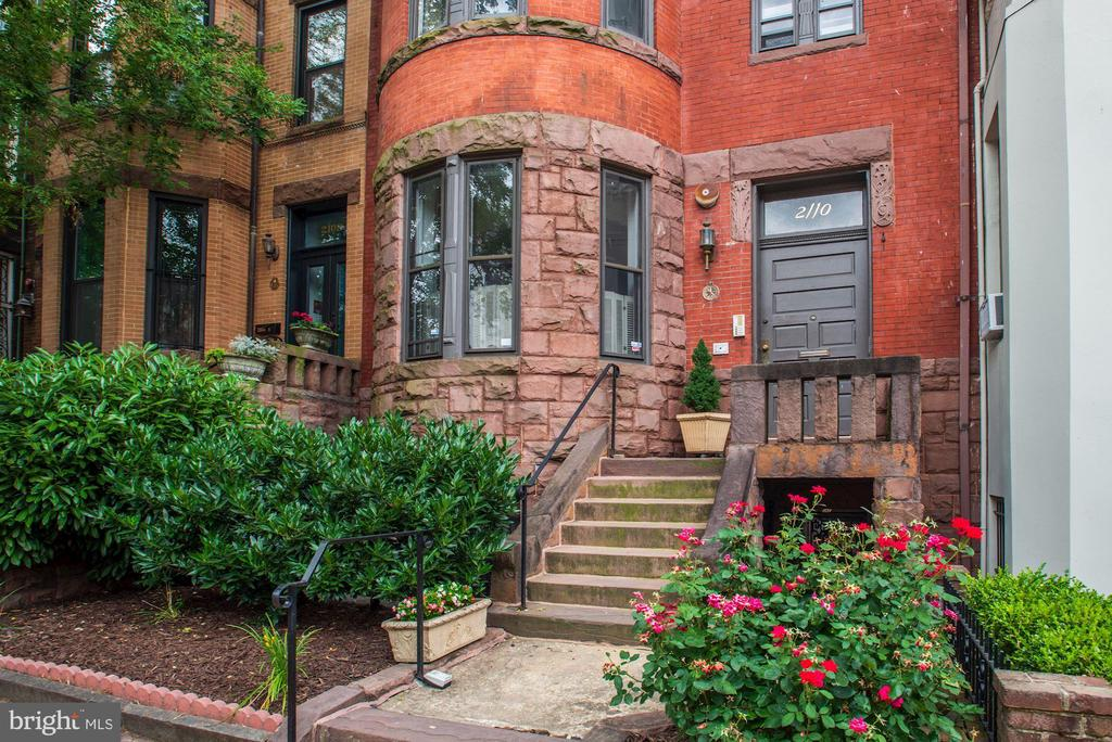 OPEN HOUSE SUNDAY December 6, 2020  from 2:00 to 4:00.  Terrific space (2000 SF!) in a beautiful Romanesque townhouse built in 1892 by Appleton  Clarke , Jr who had studied under Alfred Muse, architect of the Old Executive Office Building. The exterior is unchanged from its early building permit with its 'deep red walls, heavy brownstone rustication and slate roof.  Attached Romanesque row houses are unusual and the 2100 block of O Street is an exception with its visually integrated line up of brownstones.  Round and square bays alternate  with similar, but not identical, masonry, massing, detailing and coloration.  Together they give a wonderful aesthetic and architectural energy to the street.    This 3BR 3.5BA apartment is the top two floors and has a wonderful large private roof deck.  Main level has high ceilings, generous sitting and dinning areas, a cook's kitchen and two bedrooms, each with private bath. There is also a powder room in the hall.  The second  level is one spacious room with vaulted ceiling and full bath--great as a guest bedroom and/or hangout room or office --it leads to large private roof deck with fabulous city views.  One separately deeded parking space in the alley behind  the house conveys.