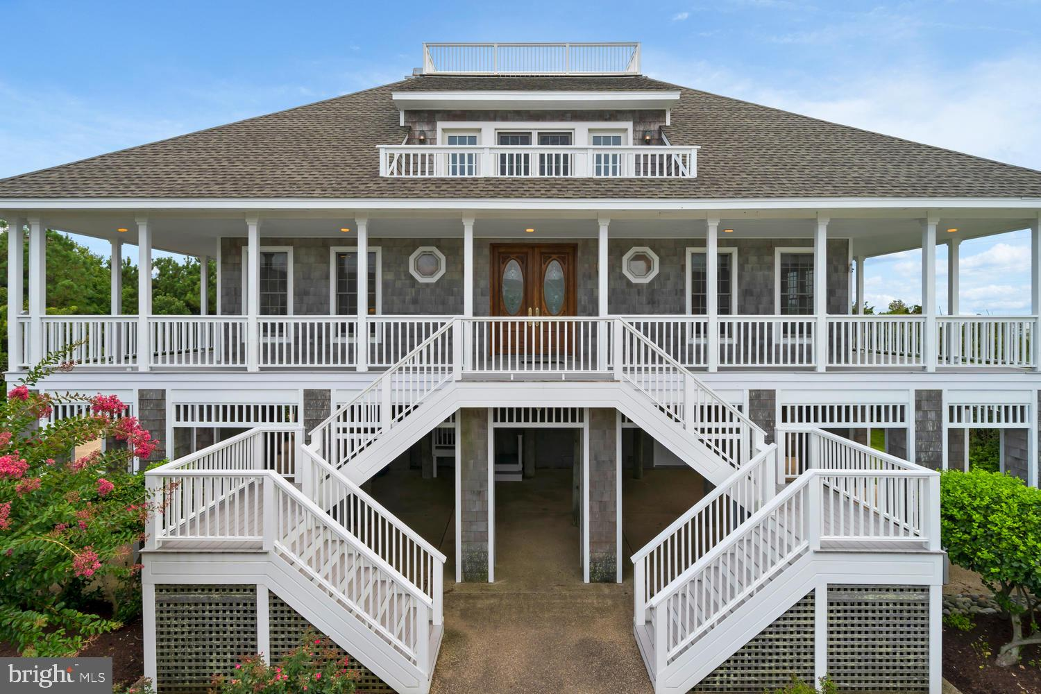 Majestic Coastal Home, Private Ocean Side Community and ROOM FOR A PRIVATE POOL!  Are you ready to effortlessly watch sunrises and sunsets over the Ocean and Bay? With nearly a 360-degree combined view of Rehoboth Bay, the Atlantic Ocean and State Park Preservation Area, 33 Hall Avenue is a unique opportunity with  4,000 +/- sq. ft. of space, boasts five bedrooms, five  baths, and is an architectural delight.   This is the kind of home that you never want to leave, yet is very close to all coastal area points of interest. Seize immediate water views from the grand second level entry:  huge great room with masonry fireplace, inviting family room, and a chef's kitchen that flows effortlessly into formal and casual dining areas.  The kitchen is all gourmet: butler/breezeway with side delivery/service entrance, wine cooler, sub-zero refrigerator, gas cooktop, double ovens, and granite counter tops.   Lounge on the expansive wraparound decking, relax on the back screened terrace with water views all day long; or stroll up to the roof top observation deck for total unsurpassed views up and down the coast. Easily take a short walk to the private beach via private seaside walkway. This home is traditionally elegant with graceful oak staircases, oak hardwood floors, solid oak doors, exquisitely tiled showers and baths (including outdoor shower), and atrium center with cupula style stained glass ceiling design as your focal point.  Perfect for broad scale entertaining! Round out the residence with almost   acre cul-de-sac lot/location shrouded by beautiful landscaping, and idyllic seclusion as you hear all that nature has to offer: waves, shore birds, breezes, and more. Attached 2 car garage, storage galore, separate laundry room, and bedrooms with private balconies! The Chancellery is a private ocean front community consisting of just 16 distinctive residences. All homes sprawl across large lots and there is private beach access via secluded boardwalk.