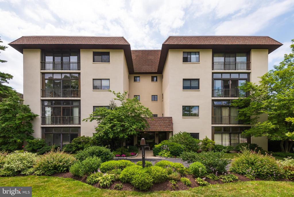 Please adhere to Covid 19 requirements by wearing mask and using disinfectant when entering home. Welcome to 432 W. Montgomery Avenue #402, Haverford, among the Main Line~s most attractive, and walkable addresses. A top floor, 2 Bedroom 2 Bath unit of the Haverford Hunt Club with amazing views, particularly sunsets. This 4th floor unit is spacious and airy with its 9-ft ceilings. The living/dining room has sliding glass doors to the south west facing balcony, great for herb and container gardening! The eat-in kitchen allows for multiple chefs. The main bedroom suite includes a full bath with a shower, and  a 6~ x 9~ walk-in closet, a separate linen closet, and more than enough room for a king size bed.  A second bedroom boasts its own large closet and is served by a separate guest bathroom with shower tub. In addition to the abundant closet space in the unit itself, including a large front hall closet, you will have your own basement storage locker as well as a storage shed off the balcony. Significant improvements to the unit include the electric panel, HVAC system, hot water heater, windows, and sliding glass door unit to balcony. The unit also has its own stackable washer/dryer and built in humidifier. This unit is true one floor living, thanks to the nearby elevator, and its doors are wide enough for handicap accessibility. The low rise, 16 unit building features great soundproofing, a newer elevator and roof, and recently refreshed common areas. The unit also has its own dedicated parking space next to the back door with street access to both Old Lancaster & Montgomery Avenues. Attractively landscaped, the property is one block from blissful Sharpe Park and Bird Sanctuary. You will also be close to excellent schools, colleges and a university, hospitals, only two blocks from Haverford Train Station,  Sharpe Park, and an easy walk to shops and restaurants in Haverford, Ardmore and Bryn Mawr. This is gracious and affordable living at its best!
