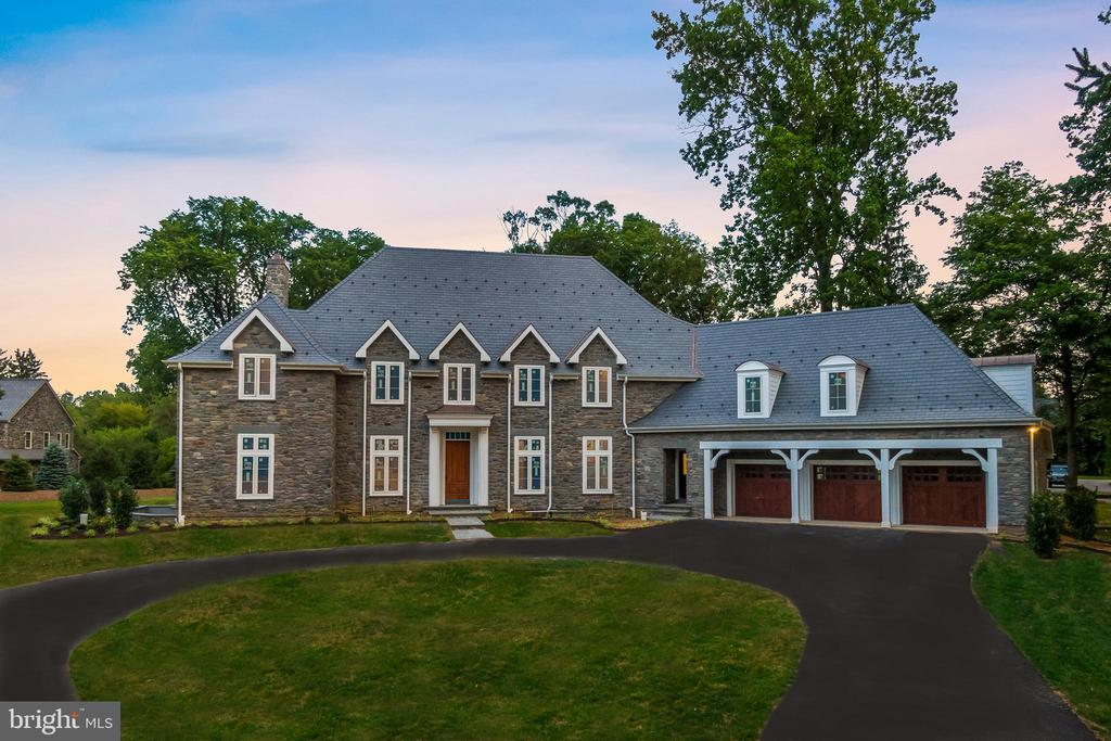 "Nearly Completed New Custom Built Stone Manor Home with an updated and inspired floor plan on a 1.5 acre homesite in the heart of Gladwyne, Pa. Gone are those formal living spaces that no family uses or wants. Instead you will find elegance tempered with a practical flow of intimate family spaces and appropriately sized entertaining areas. This Bissinger designed home pays homage to the Main Line's classic estates while embracing a modern floor plan and the lifestyle desired by today's families. Long time builder/developer Anthony Rufo uses his many years of experience building both residential and commercial new construction and has spared no expense in creating this Highest Quality Stone home. The nucleus of the home is the triad of rooms that encompass most of the first floor. The perfectly proportioned Great Room with its striking fireplace with over-sized mantel & marble surround flows seamlessly to the Gourmet Kitchen / Dining Room with the requisite large center island and seating. Details include Lancaster Custom Cabinetry custom cabinets with inset doors and drawer pull-outs, Calacatta Classique quartz countertops and commercial grade appliances including a Wolf stove / Sub-Zero refrigerator and Bosch dishwasher. The unique and thoughtfully designed walk-in pantry/ butler kitchen with custom cabinetry, second DW, convection steam oven, Wolf coffee station, warming drawer & prep sink make this kitchen a chef's dream. The adjacent ""nest""/den has a dramatic wet bar with floating glass shelves and a distinctive tile accent wall and a gas fireplace with stone surround. In addition there is a first floor Library / Office / parlor, gracious front foyer & staircase with White Oak railing and Wrought Iron spindles as well as a rear foyer by the garage & mudroom, all with extensive millwork. There are two guest powder rooms, one on each floor, and a heated 3 plus car garage with custom carriage doors and hydronic radiant floor heating. The second floor has an equally thoughtful floor plan with both front and rear foyers, extra closets and custom storage, an upstairs guest powder room/half bath, laundry room, five bedrooms, four full baths, and a walk-up attic. Retreat to your dreamy master suite with its huge custom outfitted walk-in closet/room, gorgeous master full marble bath, sleek soaking tub, over-sized glass shower, dual vanities as well as a vanity station. Master Bedroom with marble fireplace and built-in coffee station. The home's rare to find custom design creates an airy contemporary feel with site finished, wide plank White Oak hardwood flooring, hand crafted white trim with simple lines and has marble accents to lend a comfortable feel to it's old world craftsmanship. Three fireplaces with stone surrounds and both coffered and tray ceilings enhance the home. All the closets have hand crafted wooden closet organizers. Finished Lower Level with Walk Out, hydronic radiant floor heating and a full bath. (Additional bedroom, wine cellar, work-out room or bar could be added at additional cost.) Exit the Great Room to a covered Blue Stone patio with antique barn timber ceiling and posts. The large lot and expansive grounds will accommodate additional amenities such as a heated pool, pool house, additional garages or outbuildings. There will be no need to upgrade this thoughtfully constructed home which is already out-fitted with commercial level gas service and a water cooled commercial grade generator. This is NOT your ordinary NEW CONSTRUCTION and is constructed with the finest vision and craftsmanship- including Wissahickon Schist stone exterior facade, Lifetime Synthetic Slate roof with copper standing seam dormer barrel roofs, copper valleys, flashings and snow guards, Blue Stone lentils and steps all with uncompromised construction detail. Finished photos to follow......"