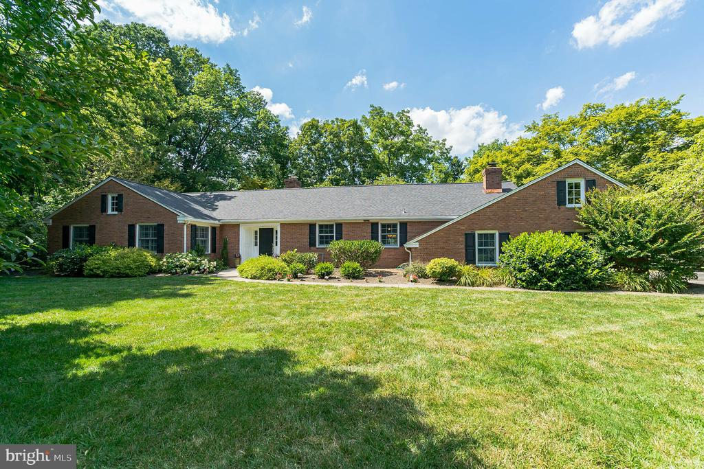 Welcome to 2058 Fox Creek Road in an ideal Berwyn location in Buttonwood Farms! This brick ranch house offers ONE-FLOOR living on a truly beautiful level 1-acre lot in TE School District. As you pull up to the house, you'll be impressed by the curb appeal and notice the new roof (June 2020). Step into the entrance hall with large coat closet then straight into the large living room with built-in book cases, wood burning fireplace and a beautiful picture window with a view of the backyard. The formal dining room adjoins the large eat-in kitchen with white cabinets and granite countertops. From the kitchen past the pantry into the step-down family room with a large closet, updated powder room and door to the new patio and spacious, flat backyard! The family room is highlighted by the raised hearth, floor to ceiling stone fireplace and recessed lighting. Don't miss the hardwood floors throughout most of the 1st floor and the walk-up to attic storage. To the bedroom wing, 3 spacious bedrooms are served by the hall bathroom. Don't miss the master suite with plantation shutters and a beautifully renovated en suite bathroom with tile floor and oversized shower! The lower level is finished into an awesome recreation/TV viewing space with another large full bathroom and walk-up to grade. There's still more room for the laundry/utility room and storage. All of this and minutes to Paoli restaurants, shopping center, and of course the R5 train line to Philadelphia.